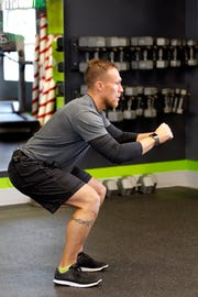 Eric Gramza, owner and personal trainer at bodyfuel inc., breaks down the Burpee. The first movement is the basic squat.