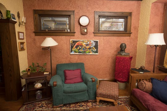 Two walls of Linda Freund's living room are painted the color of old copper pennies; the others are light gold.