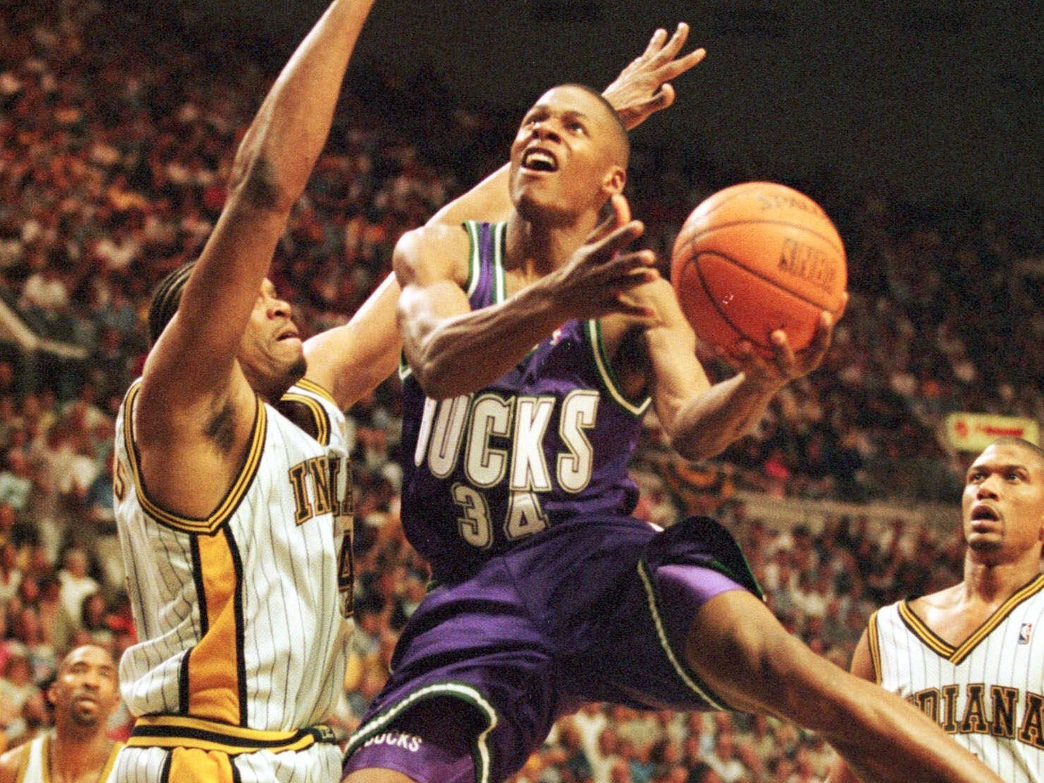 1999: Milwaukee Bucks' Ray Allen (34) drives against Indiana Pacers' Sam Perkins (left) and Jalen Rose (right) during the second quarter of the first round of the Eastern Conference playoffs in Indianapolis on May 9, 1999.