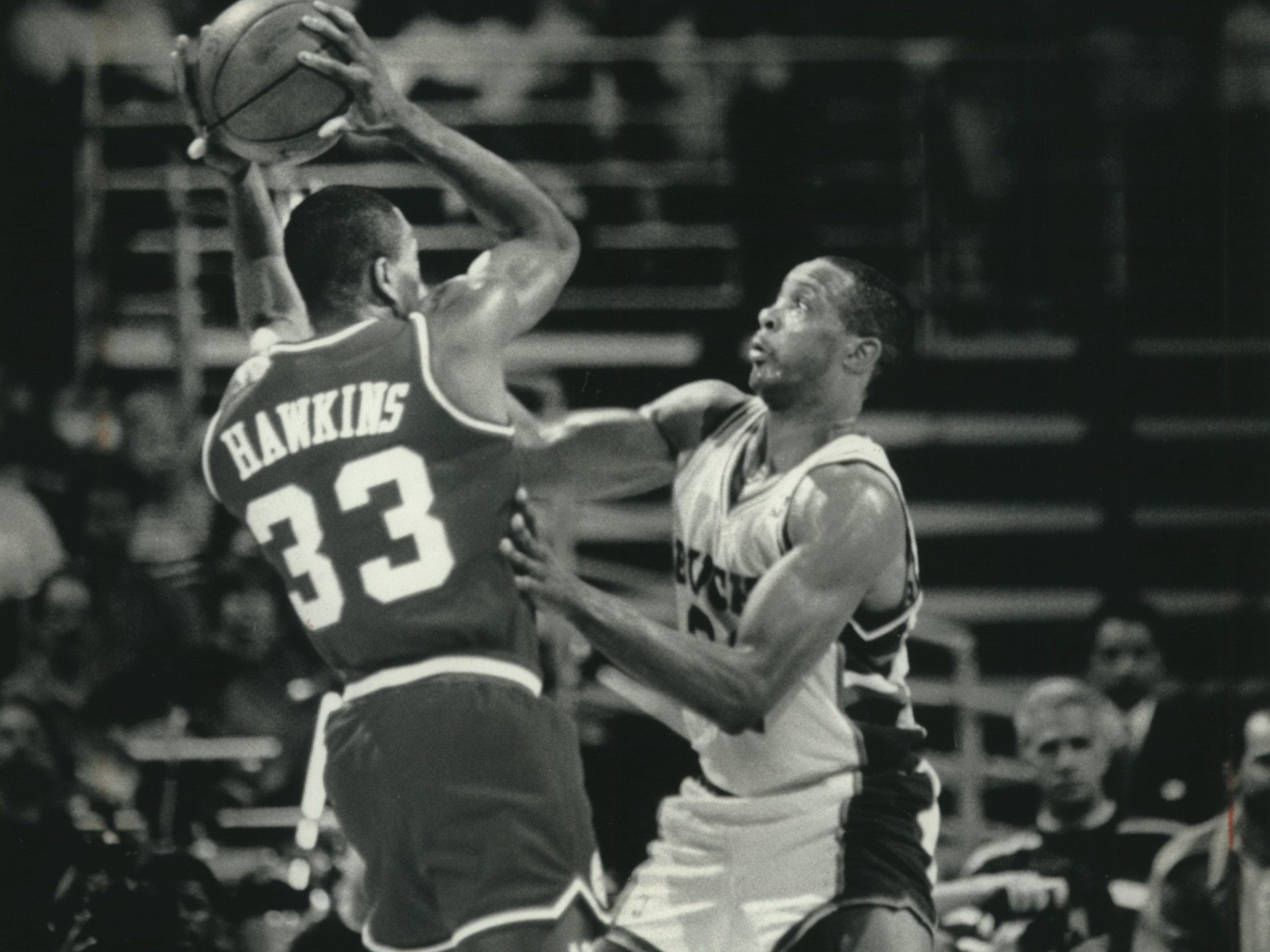1991: Alvin Robertson pressures Philadelphia 76ers guard Hersey Hawkins during Game 2 of the first round of the Eastern Conference playoffs on April 27, 1991, at the Bradley Center. Despite Robertson's 31 points, the Sixers won the game, and swept the playoff series. This photo was published in the April 29, 1991, Milwaukee Journal.