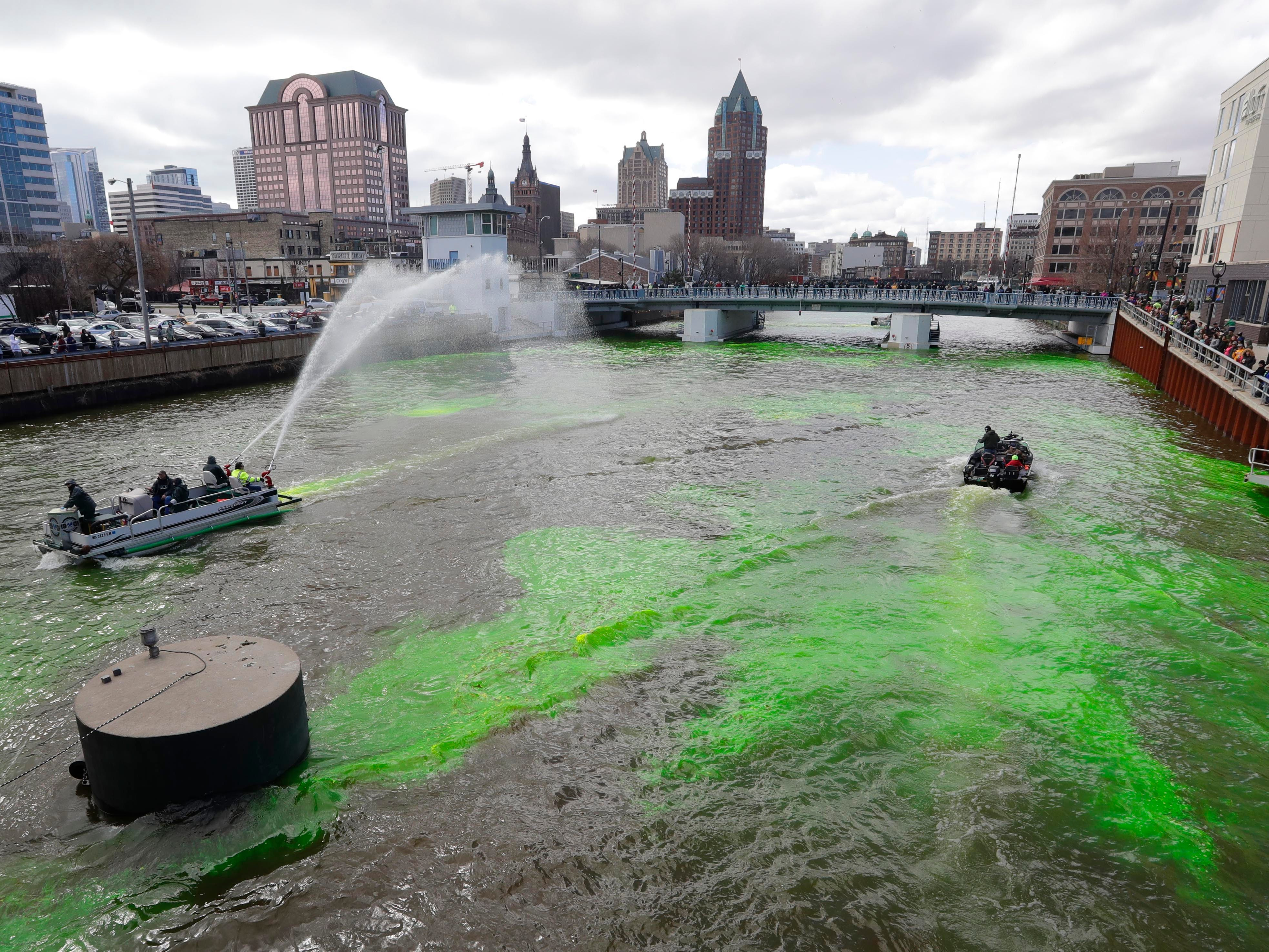 Excitement over the Milwaukee Bucks heading into the NBA playoffs this weekend is enough to turn the Milwaukee River a bright shade of green. Milwaukee Bucks president Peter Feigin and Milwaukee Mayor Tom Barrett watch as boats drop harmless green powder into the Milwaukee River near McKinley to celebrate the Milwaukee Bucks playoffs which begin Sunday.