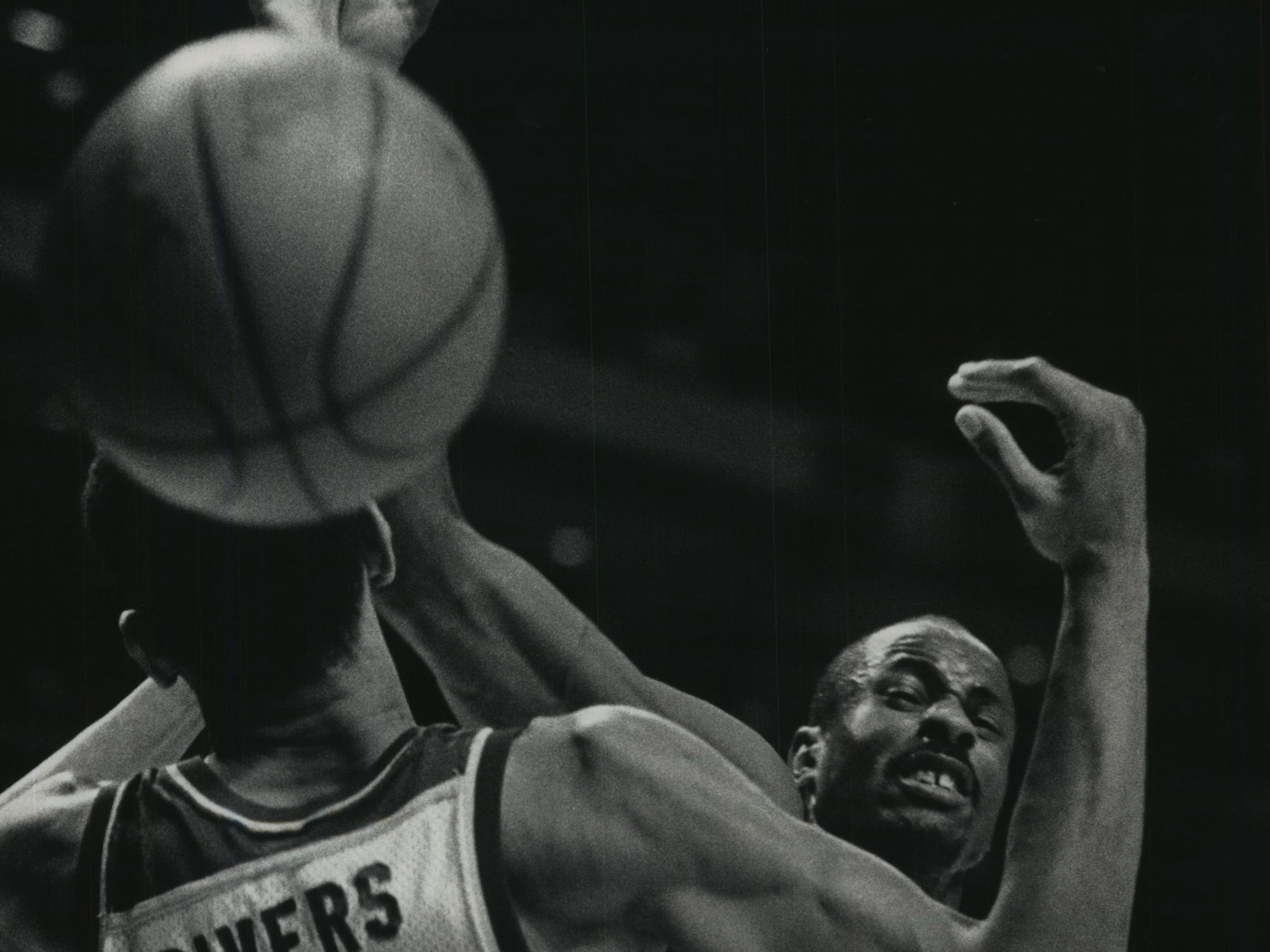 1989: Former Marquette star Doc Rivers, playing for the Atlanta Hawks, battles the Bucks' Sidney Moncrief for a loose ball during Game 4 of the first round of the Eastern Conference playoffs on at the Bradley Center on May 5, 1989. The Bucks lost Game 4 to the Hawks in overtime, 113-106. Milwaukee rebounded to beat Atlanta in the first round, only to be swept by the Detroit Pistons in the semifinals. This photo was published in the May 6, 1989, Milwaukee Sentinel.