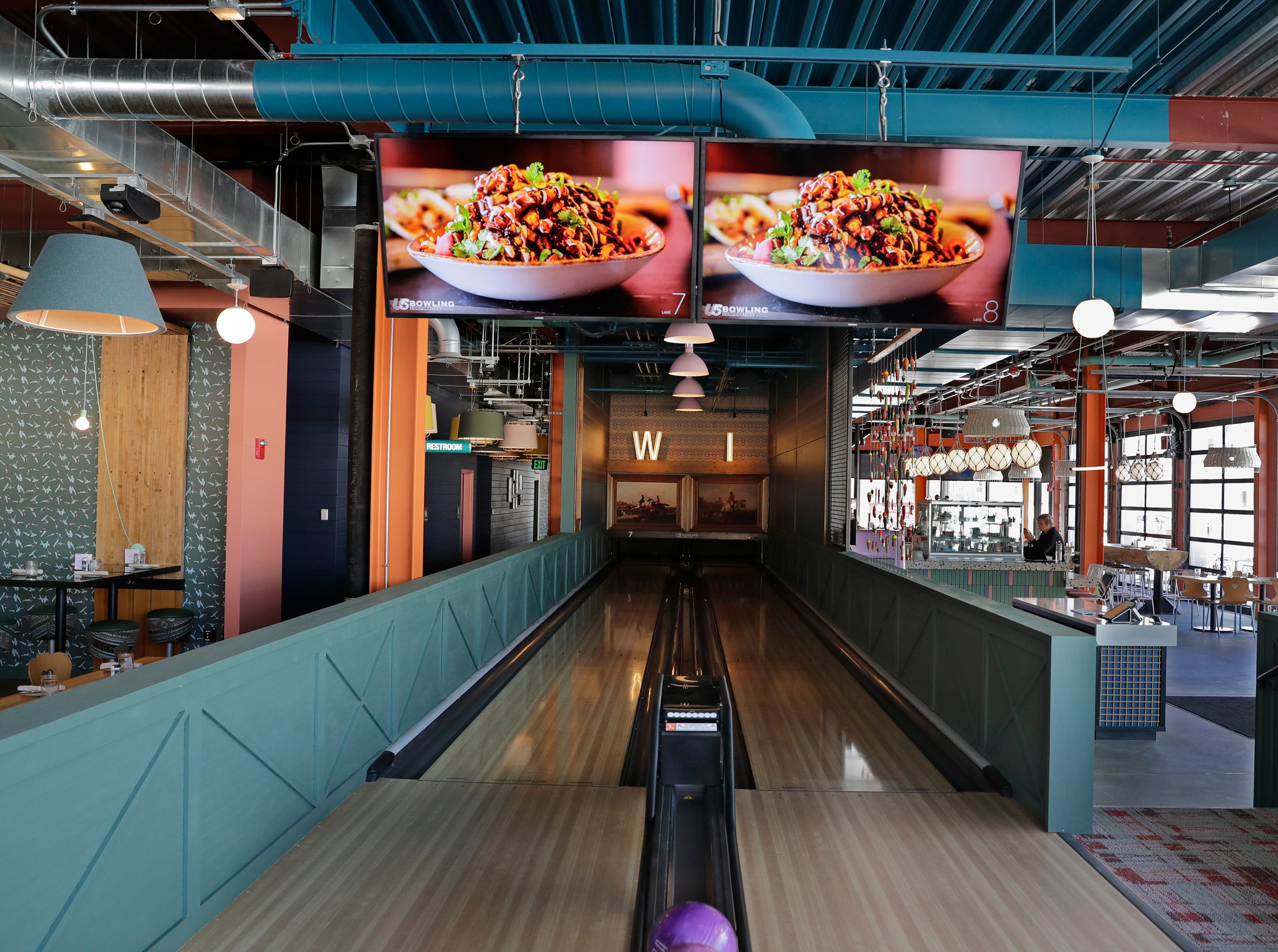 Punch Bowl Social features eight bowling alleys scattered throughout the entertainment spot.