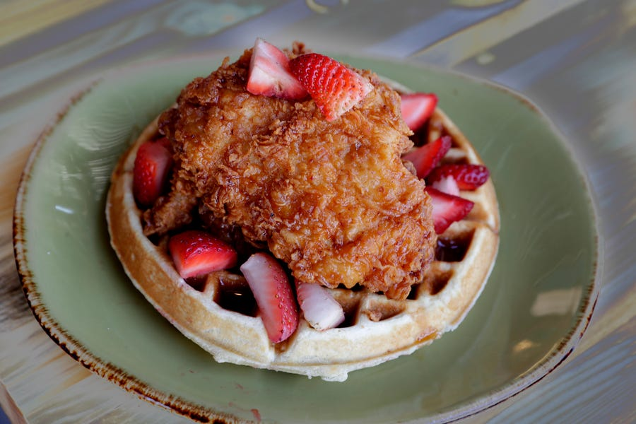 Chicken strawberry waffle  is on the menu at Punch Bowl Social.
