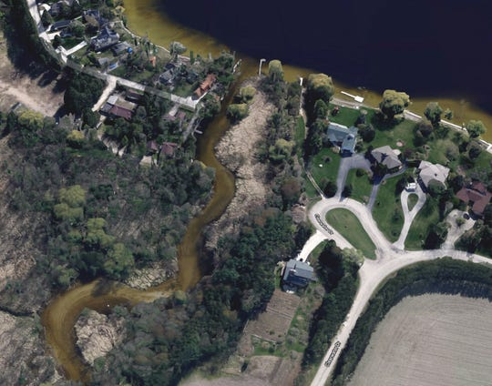 Kurt Froebel, whose home is along the Oconomowoc River (lower right), unsuccessfully fought a fine over his confrontation with duck hunters in the river behind his house. The river flows out of North Lake (above) in the Waukesha County town of Merton.