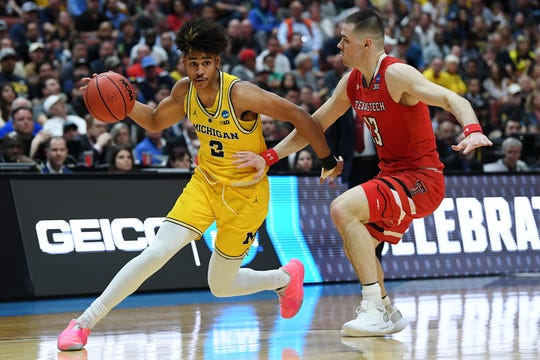 Michigan's Jordan Poole (2) drives against Texas Tech's Matt Mooney during a NCAA men's basketball West Regional game at the Honda Center in Anaheim, Calif. March 28, 2019. Photo by Harry How/Getty Images