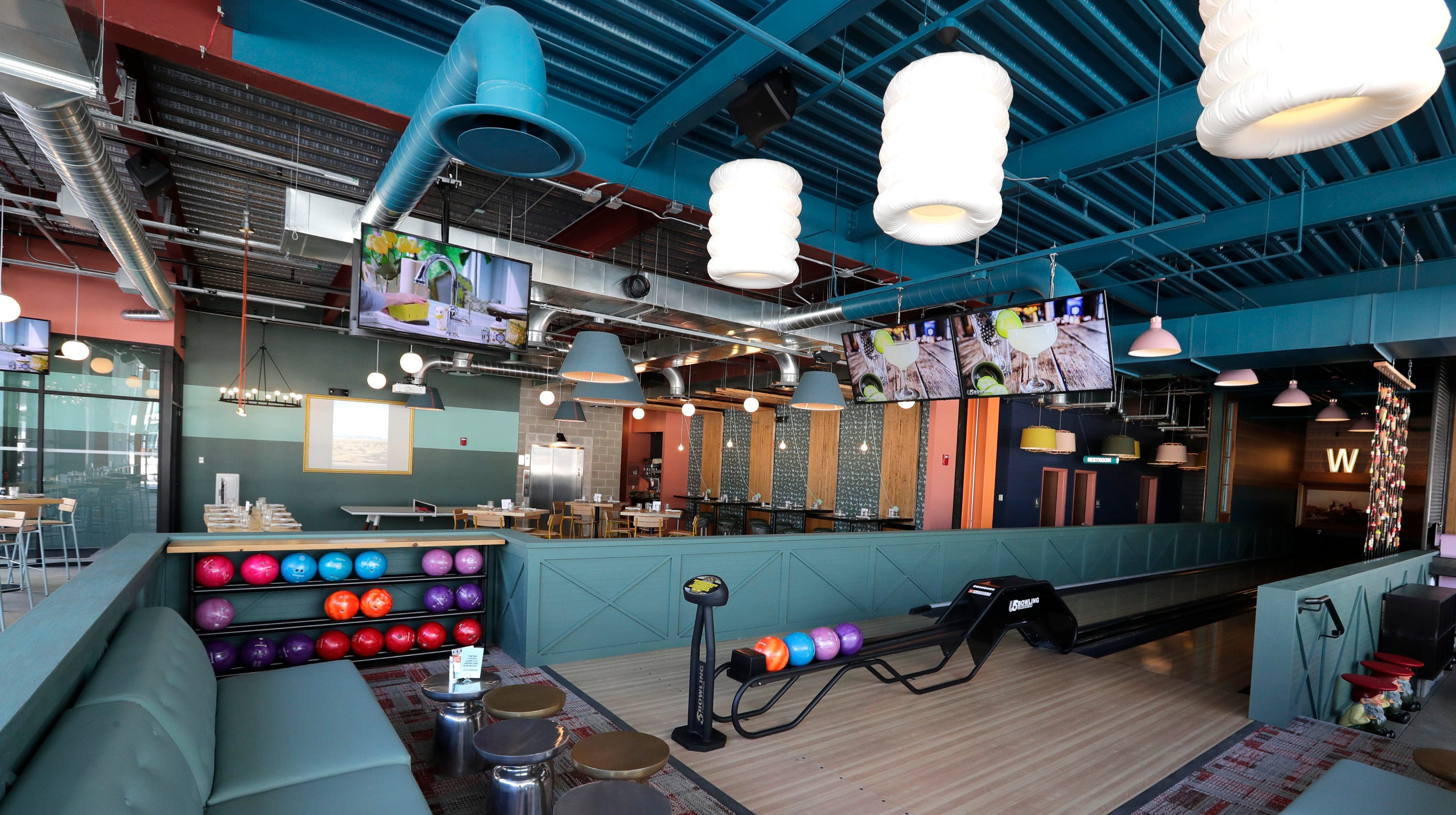 Bright colors mark the bowling alleys, as well as the balls, at Punch Bowl Social.