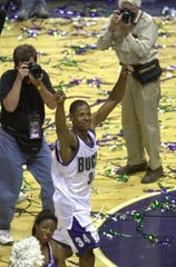Ray Allen walks off a winner after the Bucks beat the Charlotte Hornets to advance to the Eastern Conference Finals on May 20, 2001.