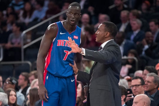 Pistons coach Dwane Casey talks to forward Thon Maker, who Detroit acquired at the trade deadline.