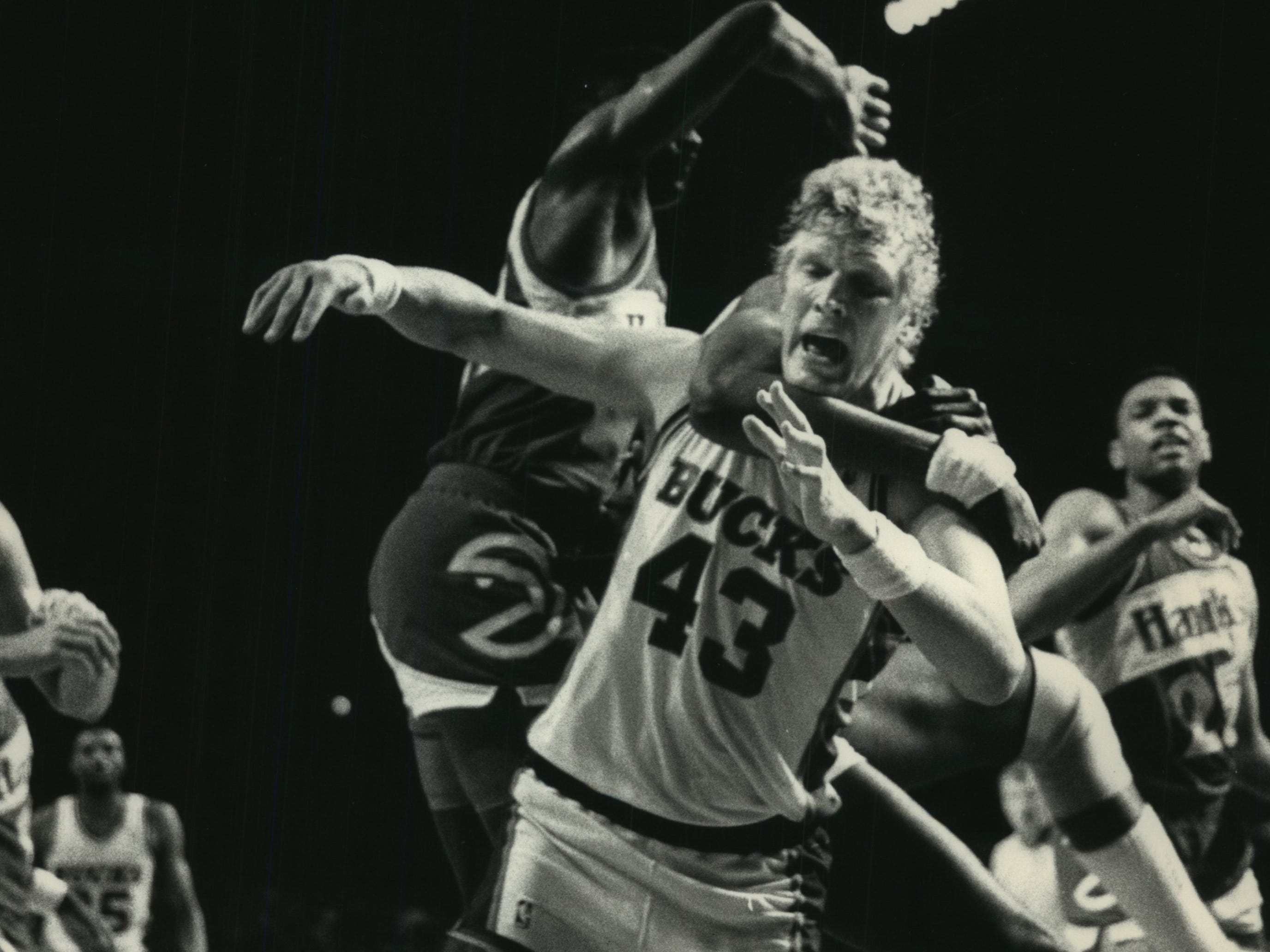 1988: Atlanta center Tree Rollins gets the Bucks' Jack Sikma in a headlock during Game 4 of the first round of the Eastern Conference playoffs on May 6, 1988, at the Milwaukee Arena. The Bucks beat the Hawks, 105-99, but lost the five-game series. This photo was published in the May 7, 1988, Milwaukee Journal.