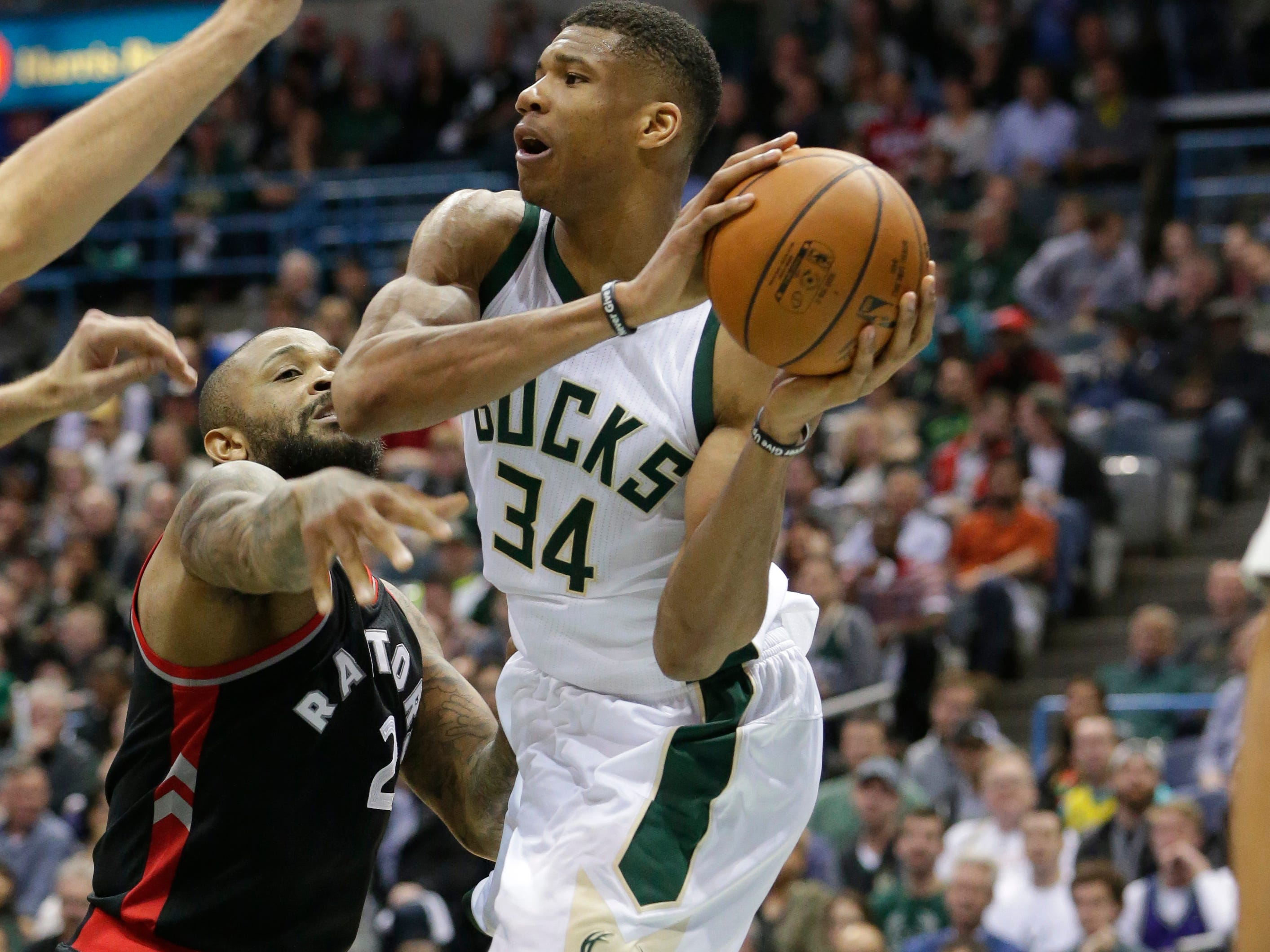 2017: Milwaukee Bucks forward Giannis Antetokounmpo makes a pass over Toronto Raptors forward PJ Tucker during the second half of Game 6 in the first round of the Eastern Conference playoffs on April 27, 2017, at the BMO Harris Bradley Center. The Toronto Raptors beat the Milwaukee Bucks, 92-89, to advance to the conference semifinals.
