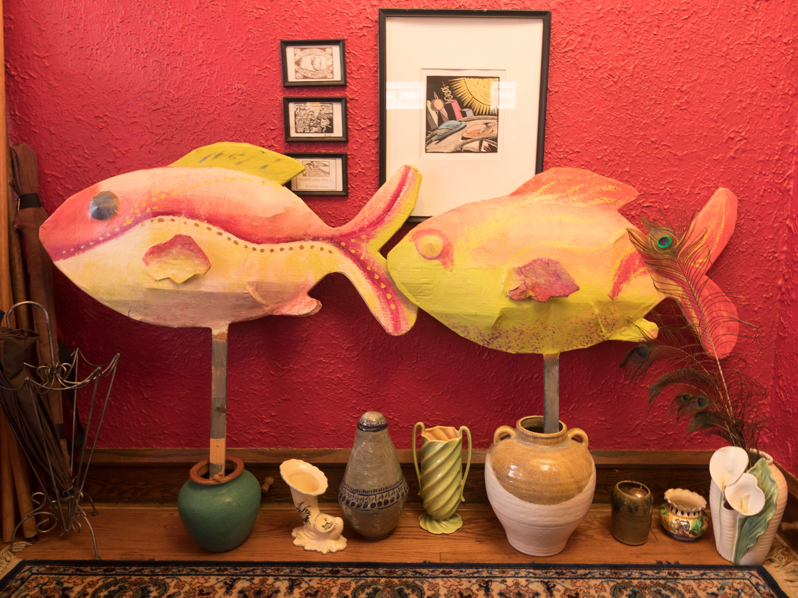 Papier-mache fish created by the homeowner greet visitors in the entryway.