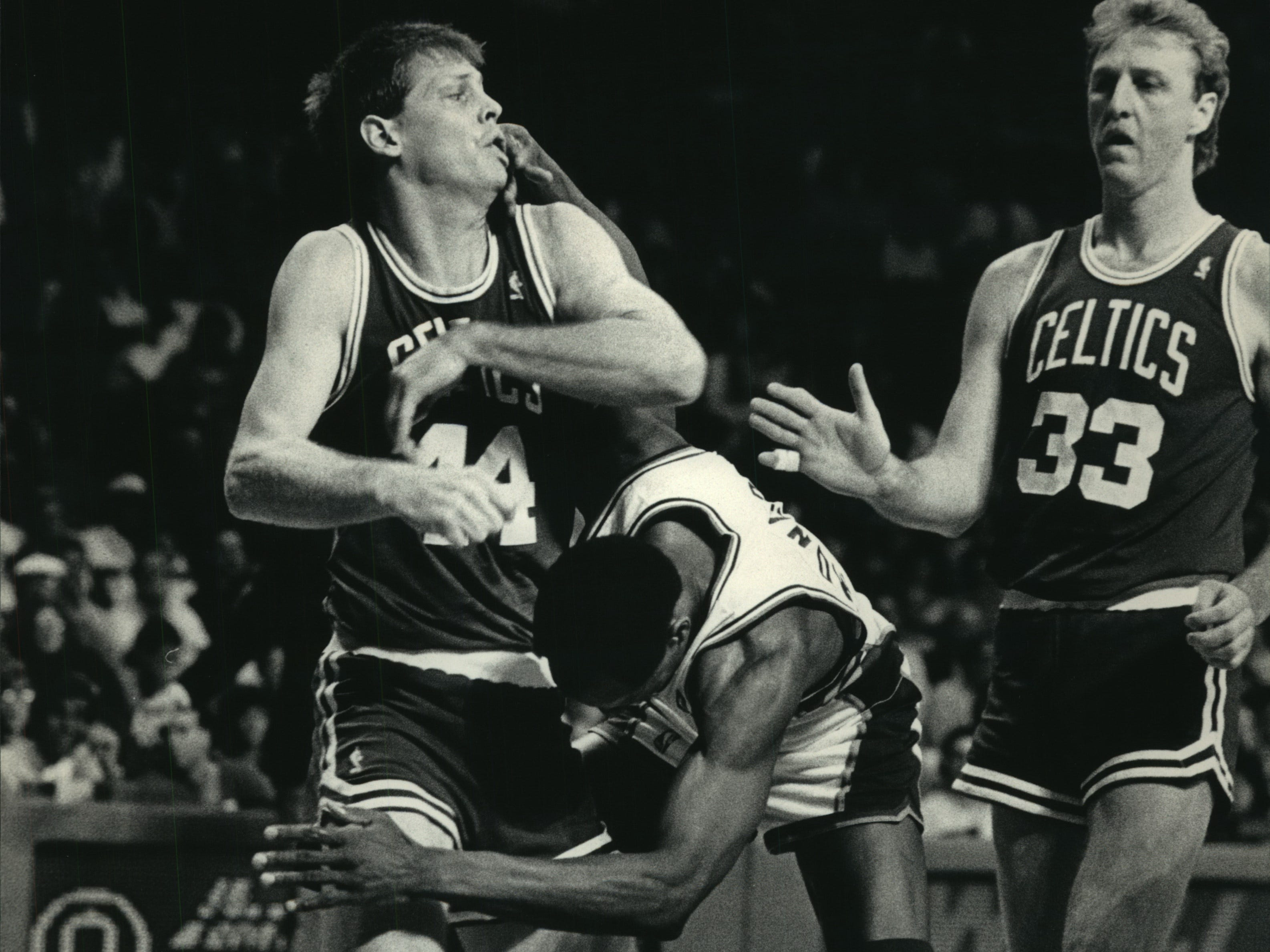 1987: Boston's Danny Ainge (left) and Milwaukee's Sidney Moncrief tangle as Larry Bird looks on during second-quarter action in Game 6 of the Eastern Conference semifinals at the Milwaukee Arena on May 15, 1987. The Bucks won the game, 121-111, but the Celtics game back and won Game 7 and the series the following day. This photo was published in the May 16, 1987, Milwaukee Journal.