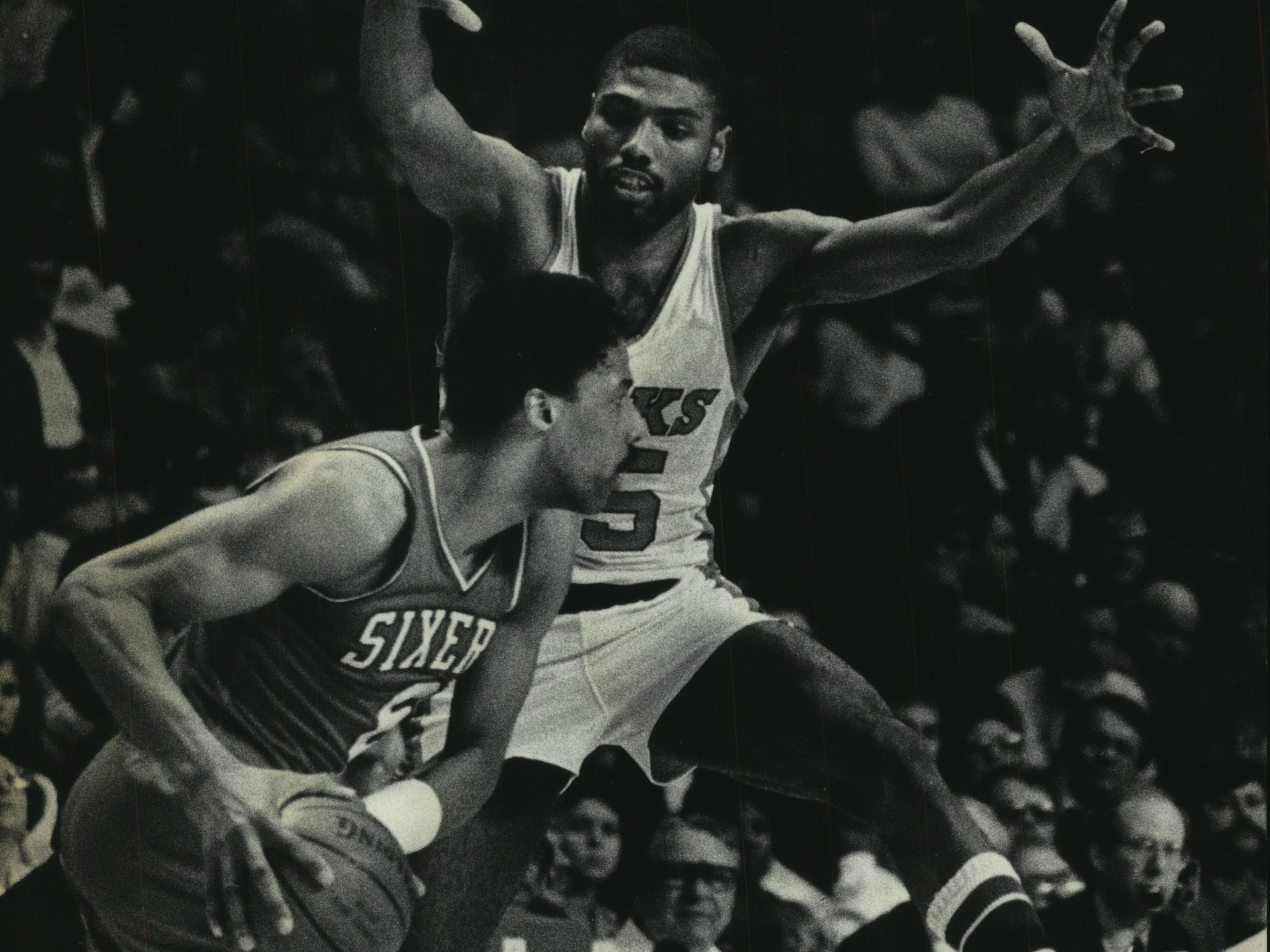 1985: Julius Erving of the Philadelphia 76ers tries to get past the Bucks' Paul Pressey in Game 1 of the Eastern Conference Semifinals on April 28, 1985. The 76ers won, 127-105, and beat the Bucks in the series. This photo was published in the April 29, 1985, Milwaukee Journal.