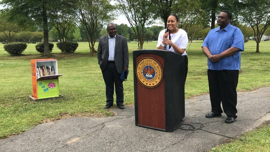 Community Affairs Director Robert Johnson, Amelia Campbell and Mayor Jamie Mayo spoke at a ribbon cutting debuting a new mobile library in Charles Johnson Children's Park.