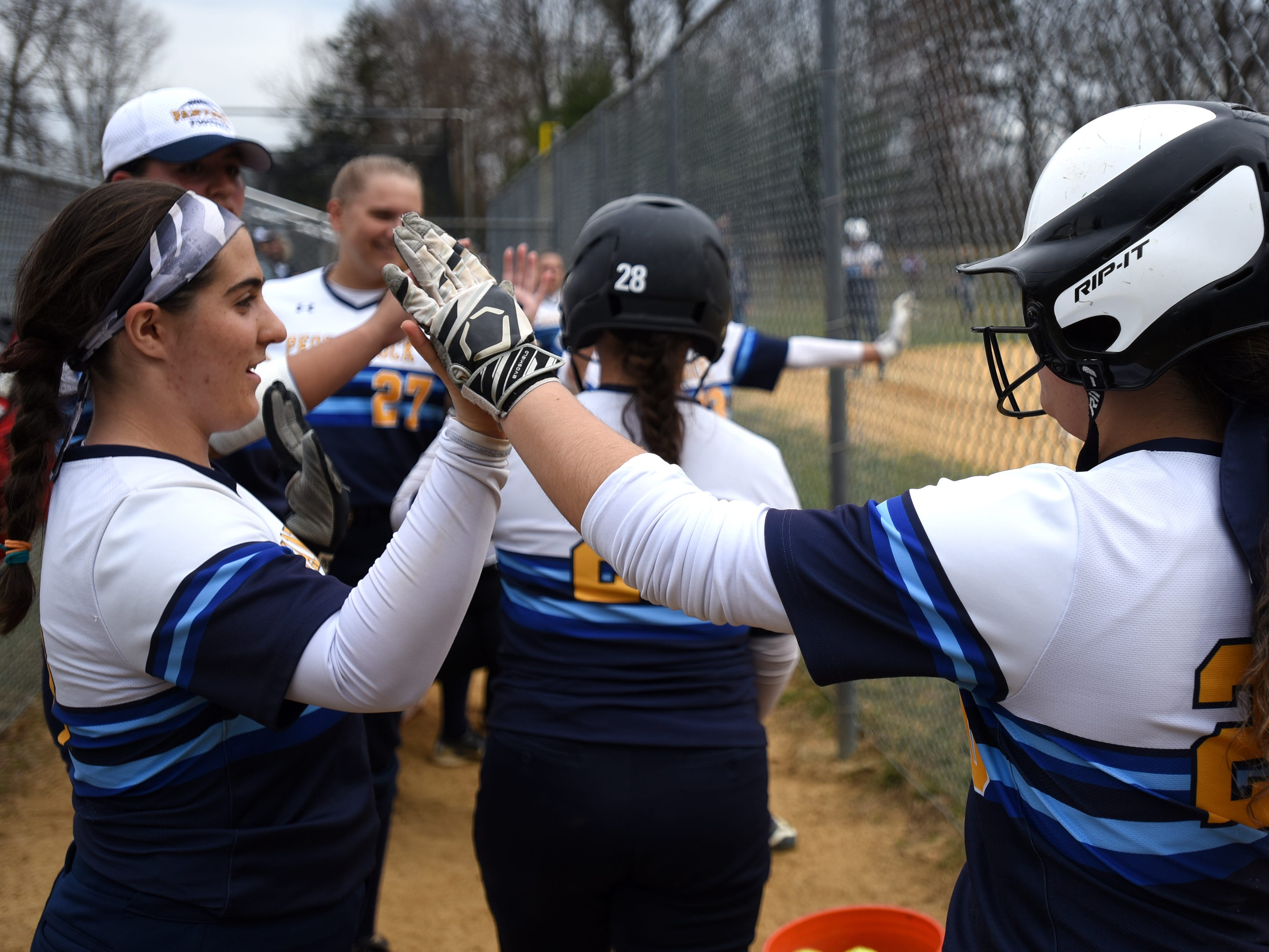 Pequannock at Kinnelon softball game in Kinnelon on Friday April 12, 2019. Pequannock players high-five one another.