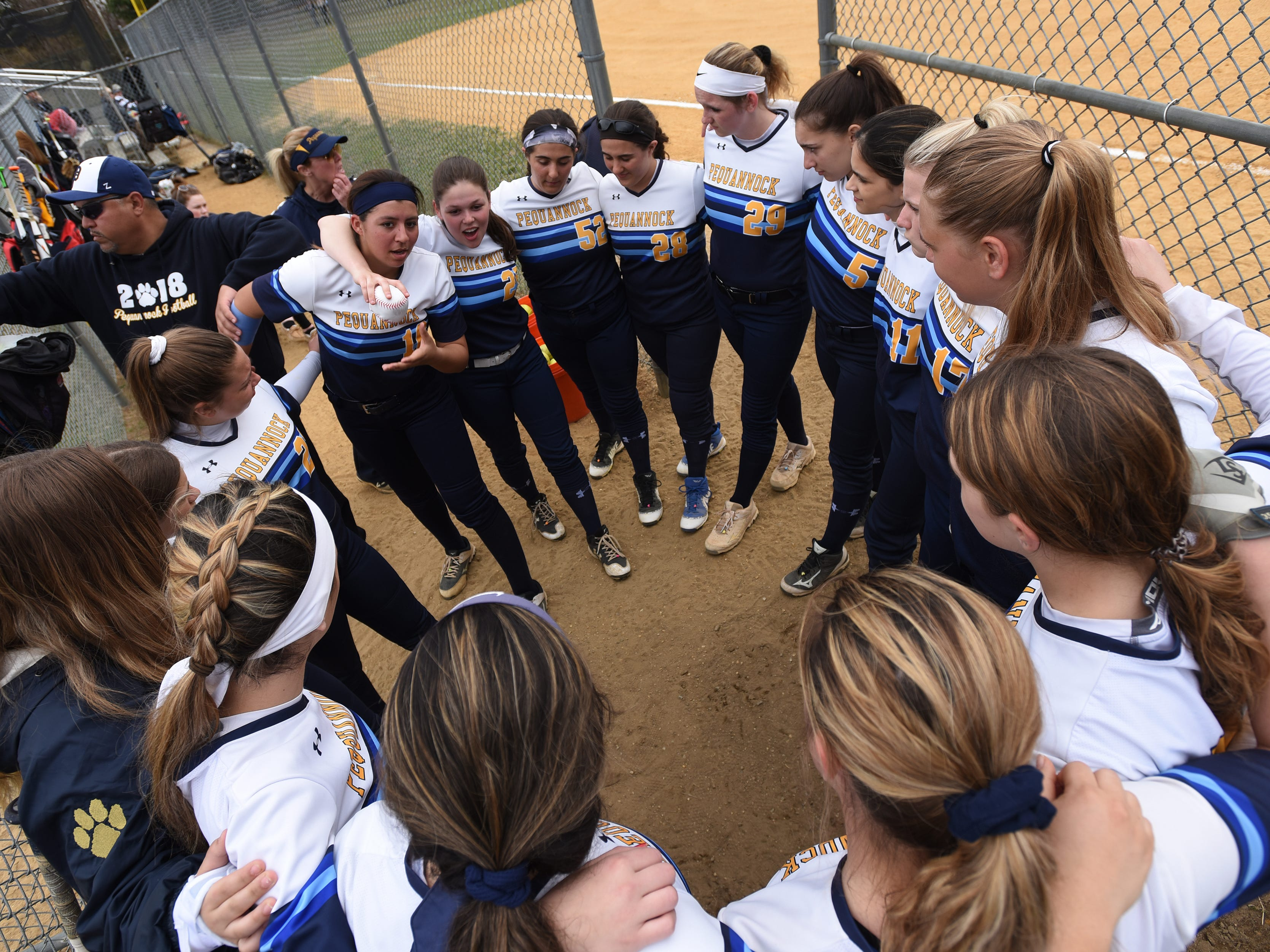 Pequannock at Kinnelon softball game in Kinnelon on Friday April 12, 2019. The Pequannock players huddle before the game.