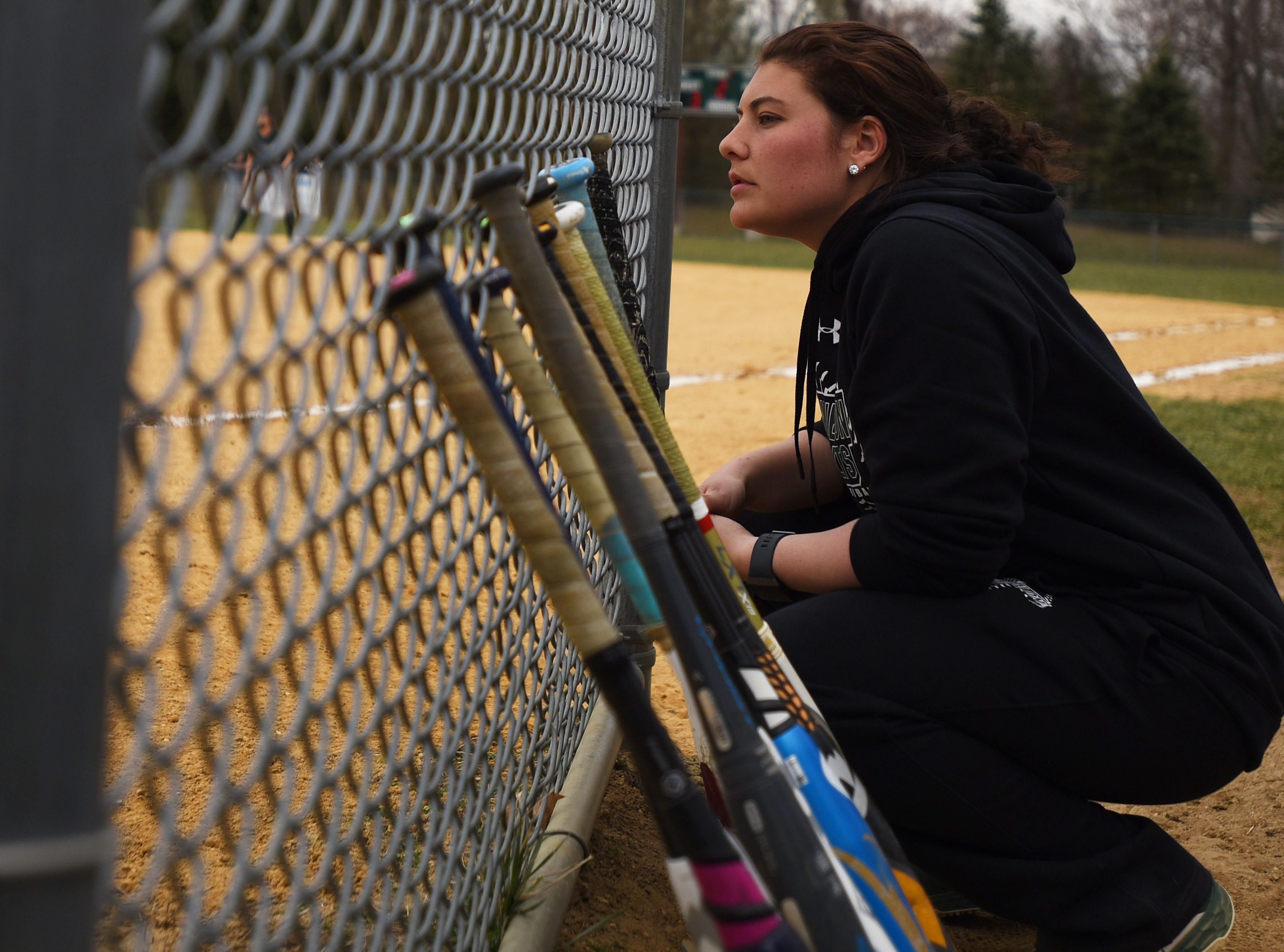 Pequannock at Kinnelon softball game in Kinnelon on Friday April 12, 2019. Kinnelon coach Marissa Bariso crouches as she watches the game.