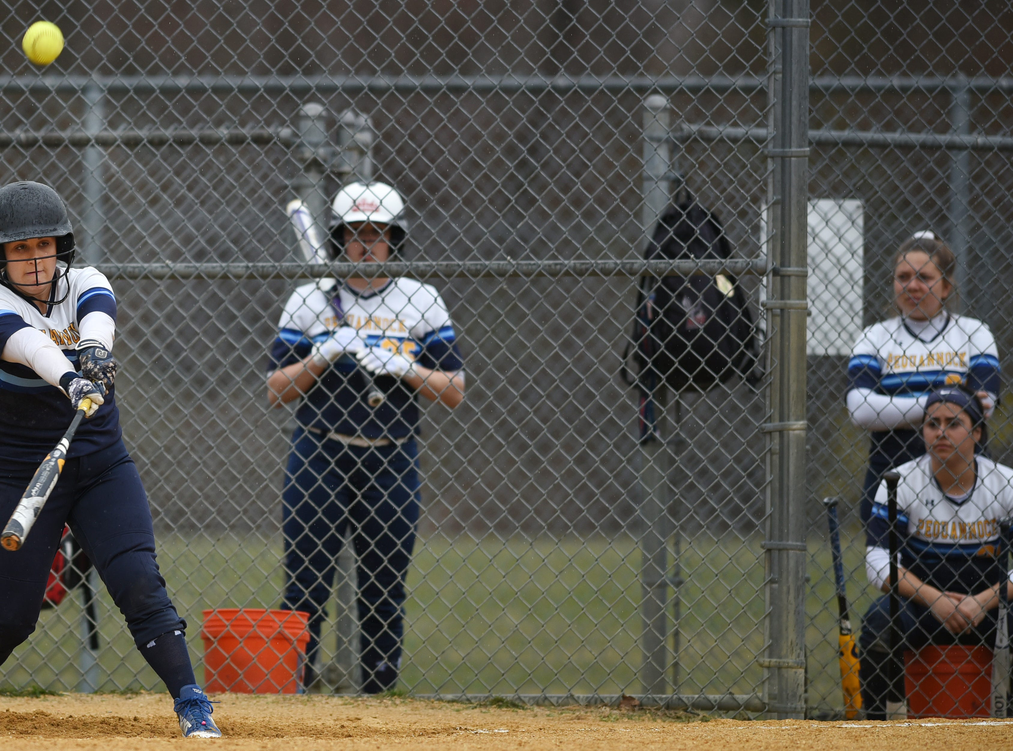 Pequannock at Kinnelon softball game in Kinnelon on Friday April 12, 2019. P#28 Shannon Wall hits the ball.
