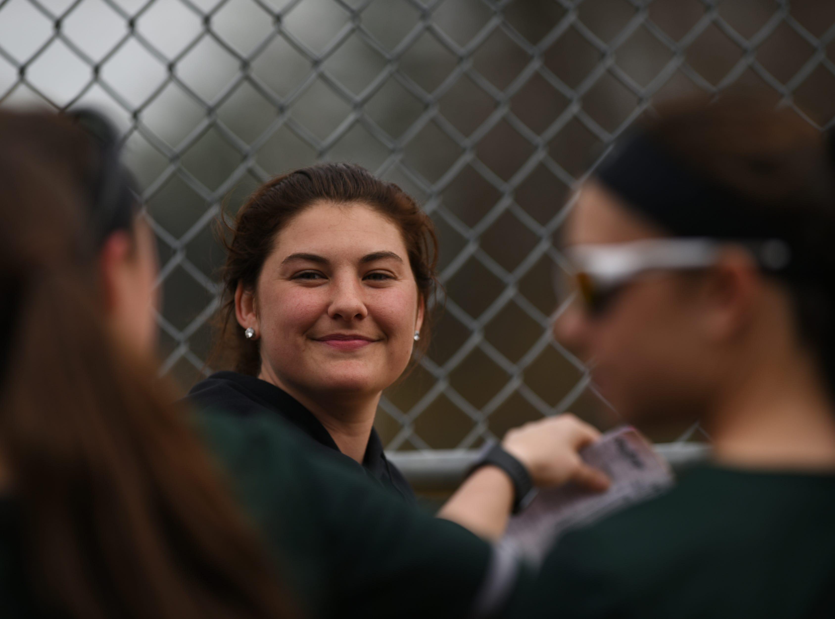 Pequannock at Kinnelon softball game in Kinnelon on Friday April 12, 2019. Kinnelon coach Marissa Bariso smiles during the game.