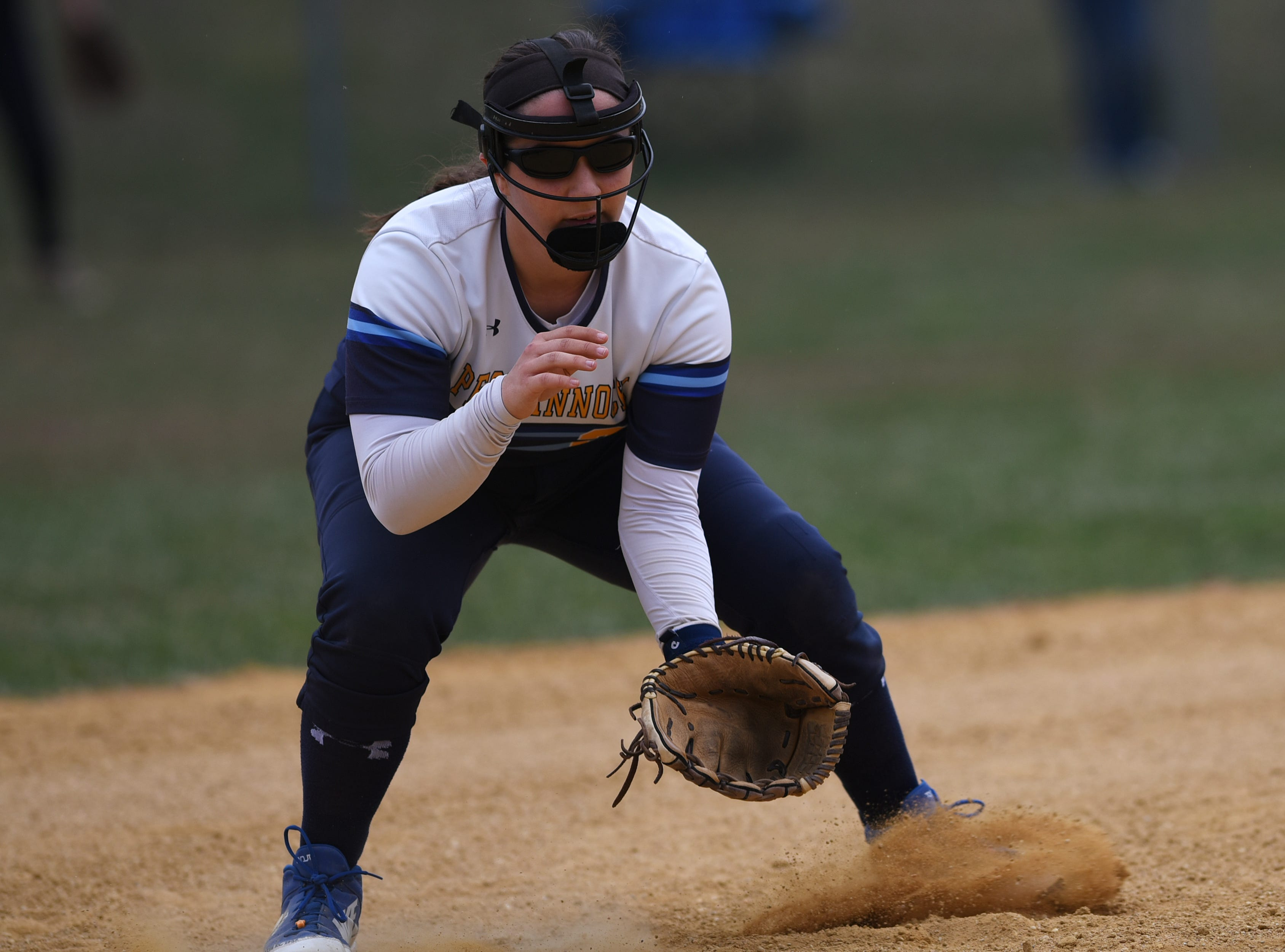 Pequannock at Kinnelon softball game in Kinnelon on Friday April 12, 2019. P#28 Shannon Wall crouches near third base.
