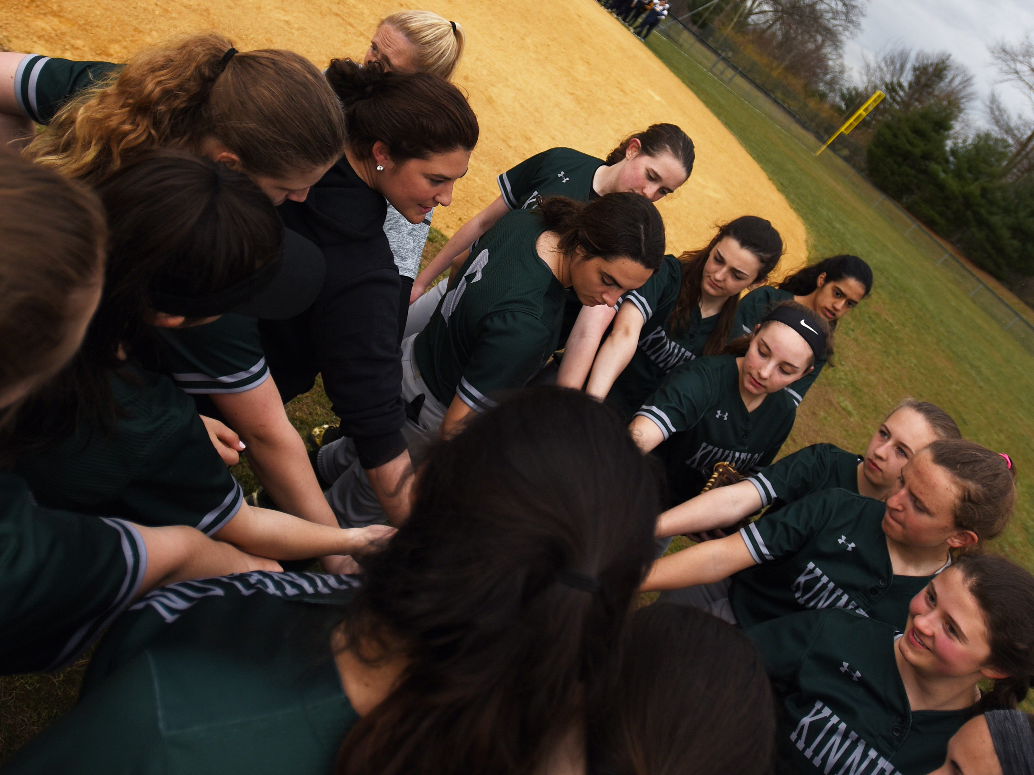 Pequannock at Kinnelon softball game in Kinnelon on Friday April 12, 2019. The Kinnelon team join in a huddle after the game.
