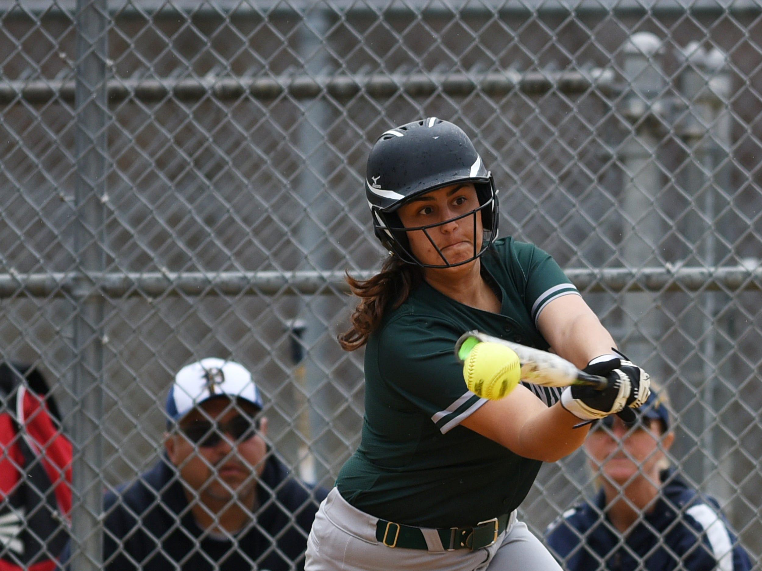 Pequannock at Kinnelon softball game in Kinnelon on Friday April 12, 2019. K#9 Renee Ritacco hits the ball.