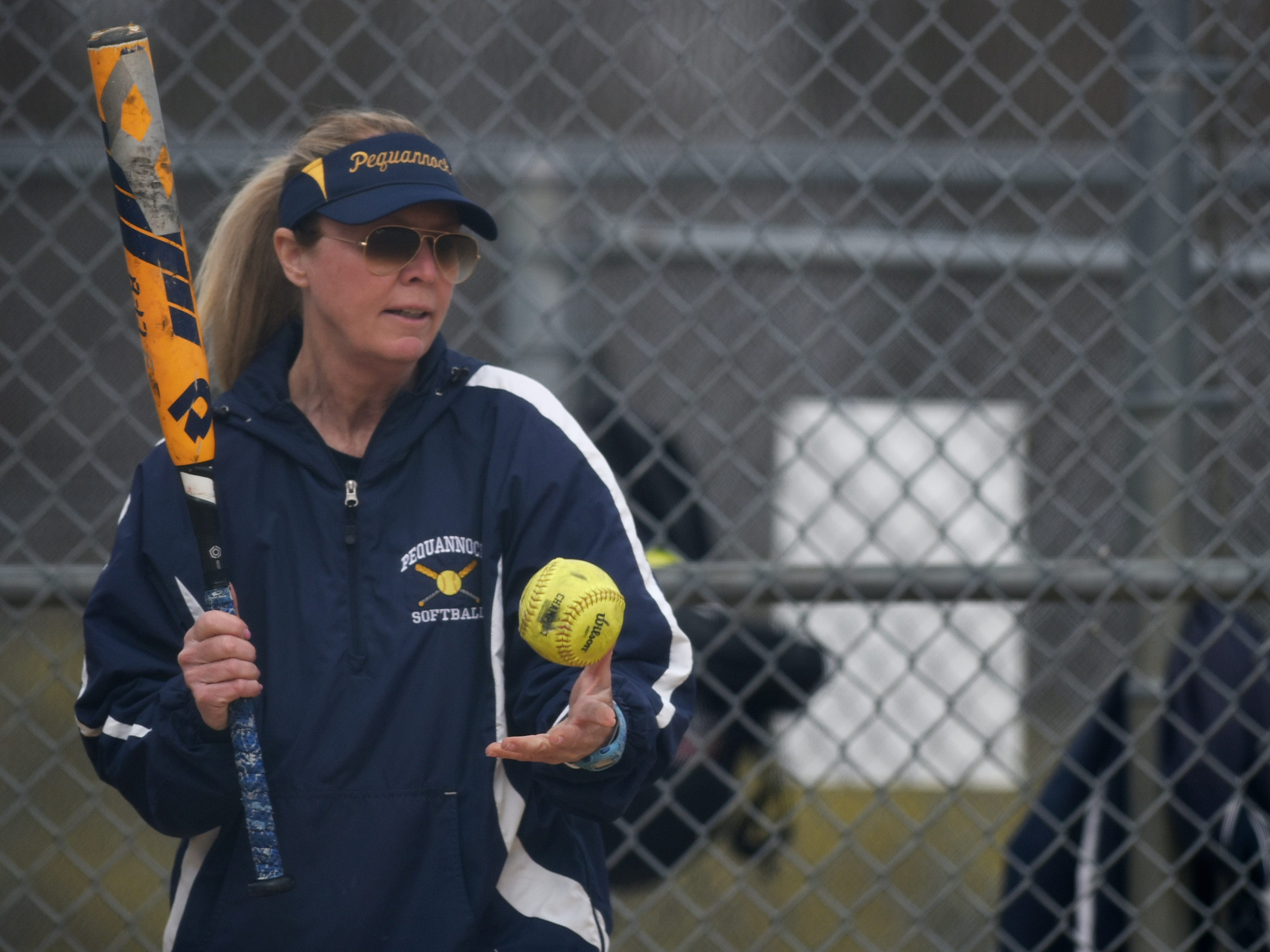 Pequannock at Kinnelon softball game in Kinnelon on Friday April 12, 2019. Pequannock coach Maryann Goodwin helps the girls warm up.