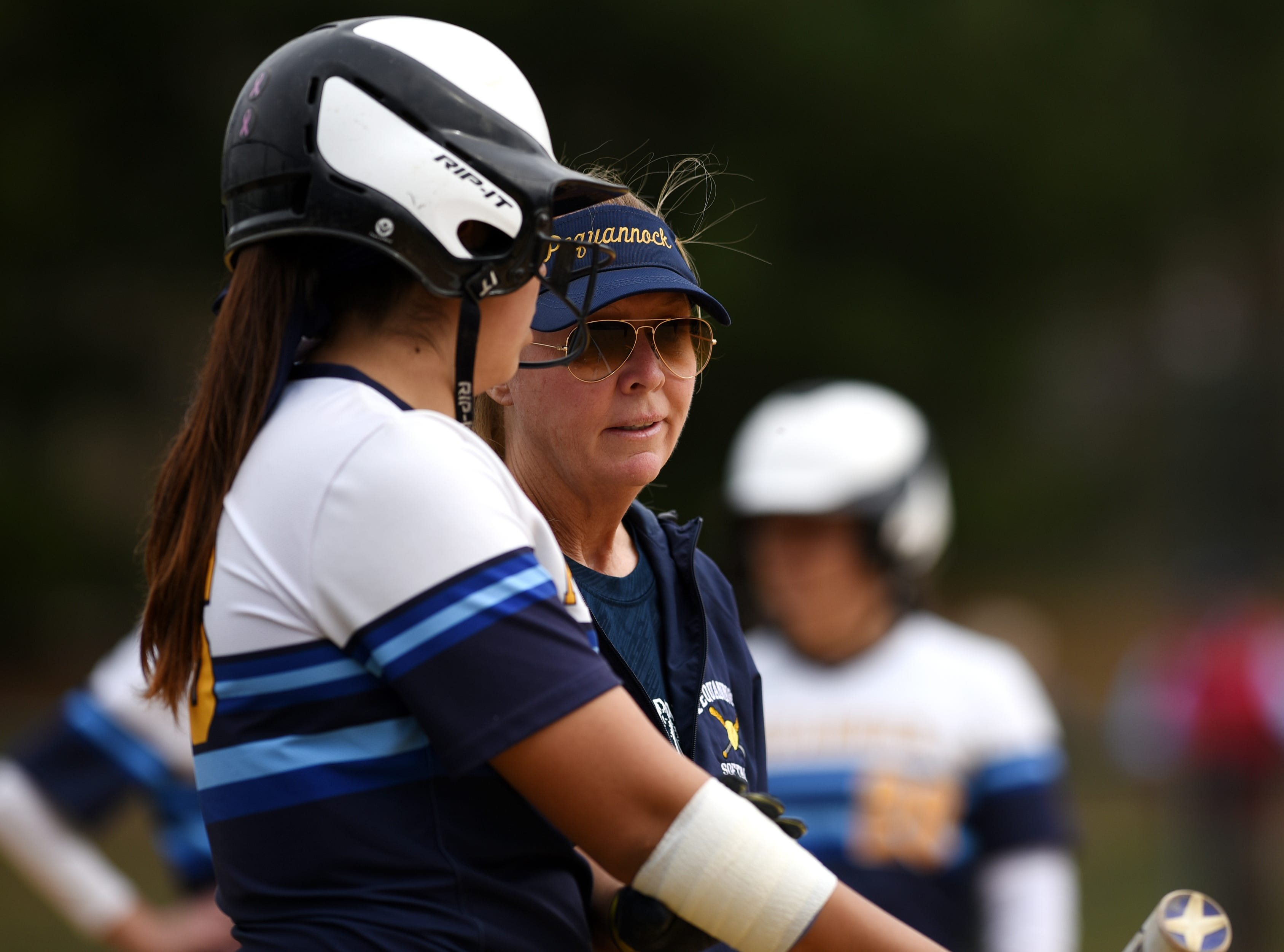 Pequannock at Kinnelon softball game in Kinnelon on Friday April 12, 2019. Pequannock coach Maryann Goodwin talks to the players during the game.