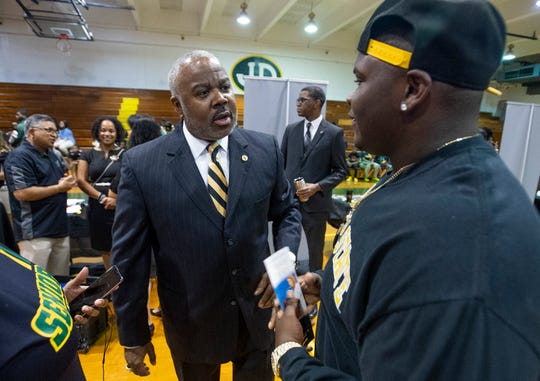 Alabama State University President Quinton Ross talks with Jeff Davis High School student Jalon Mosley during the ASU President's Tour stop at the school in Montgomery, Ala., on Friday April 12, 2019.