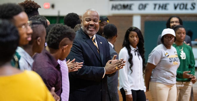 Alabama State University President Quinton Ross presents scholarships to Jeff Davis High School students during the ASU President's Tour stop at the school in Montgomery, Ala., on Friday April 12, 2019.