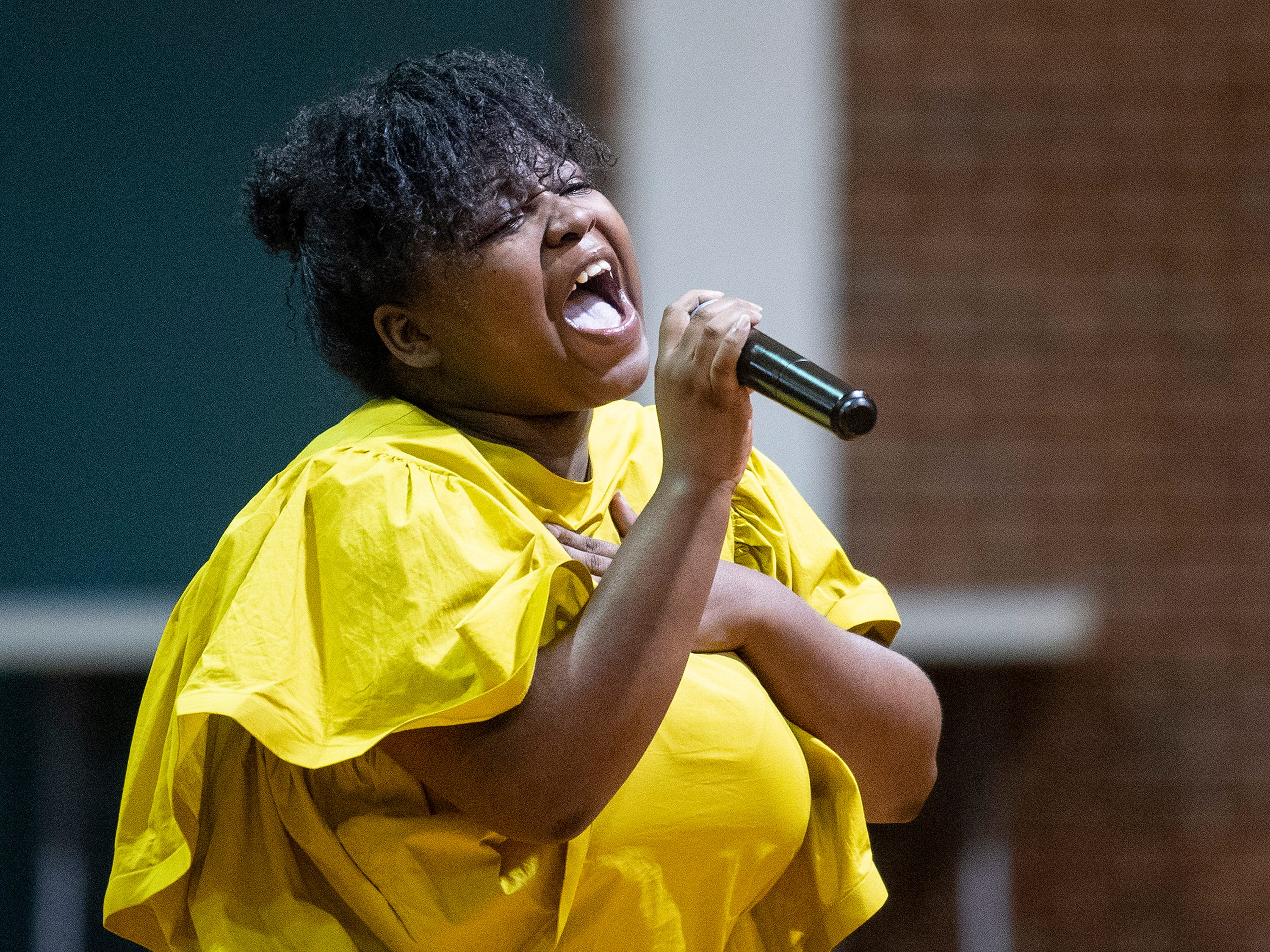 An Alabama State University student sings during the ASU President's Tour stop at Jeff Davis High School in Montgomery, Ala., on Friday April 12, 2019.