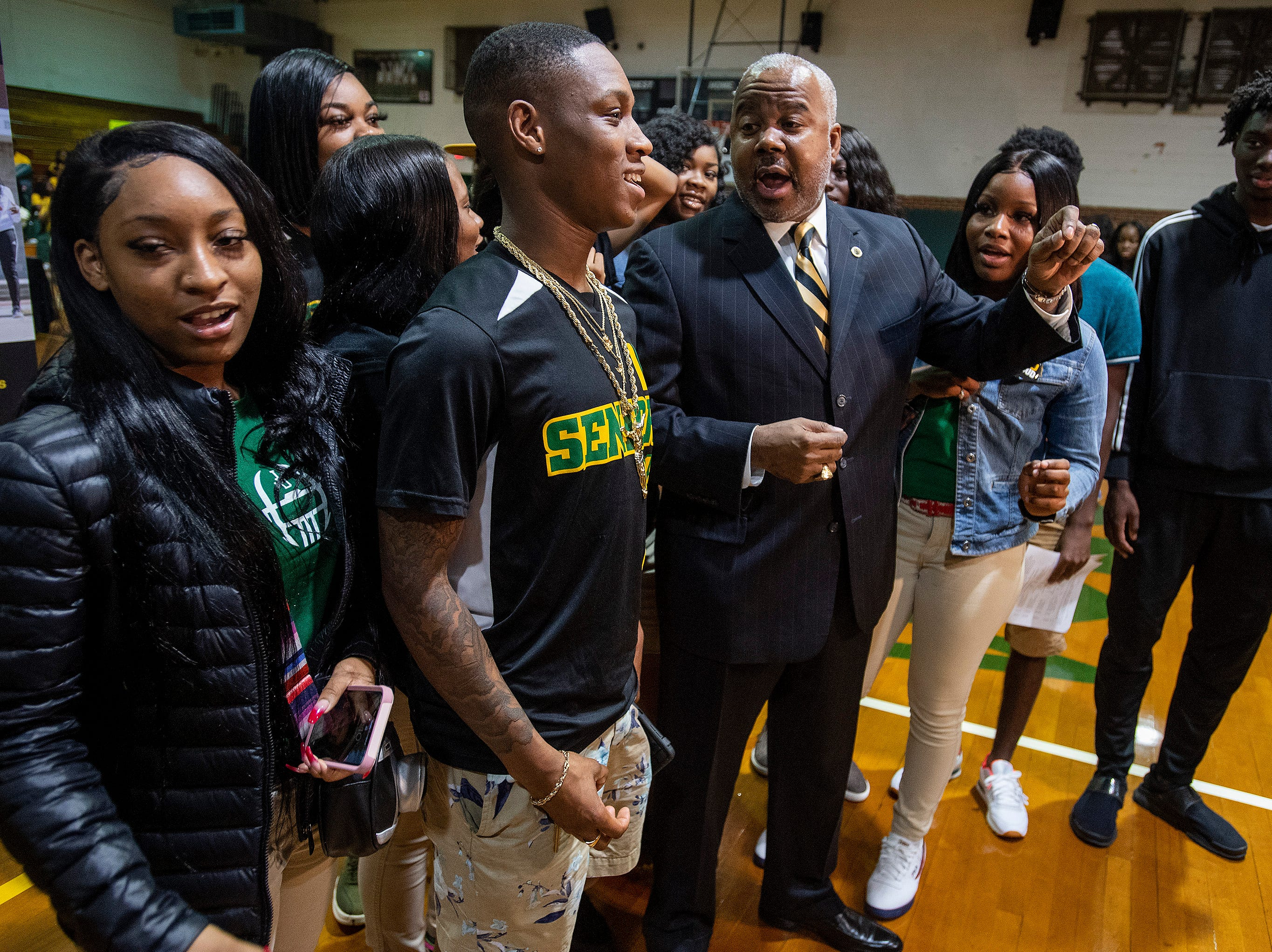 Alabama State University President Quinton Ross talks with Jeff Davis High School students during the ASU President's Tour stop at the school in Montgomery, Ala., on Friday April 12, 2019.