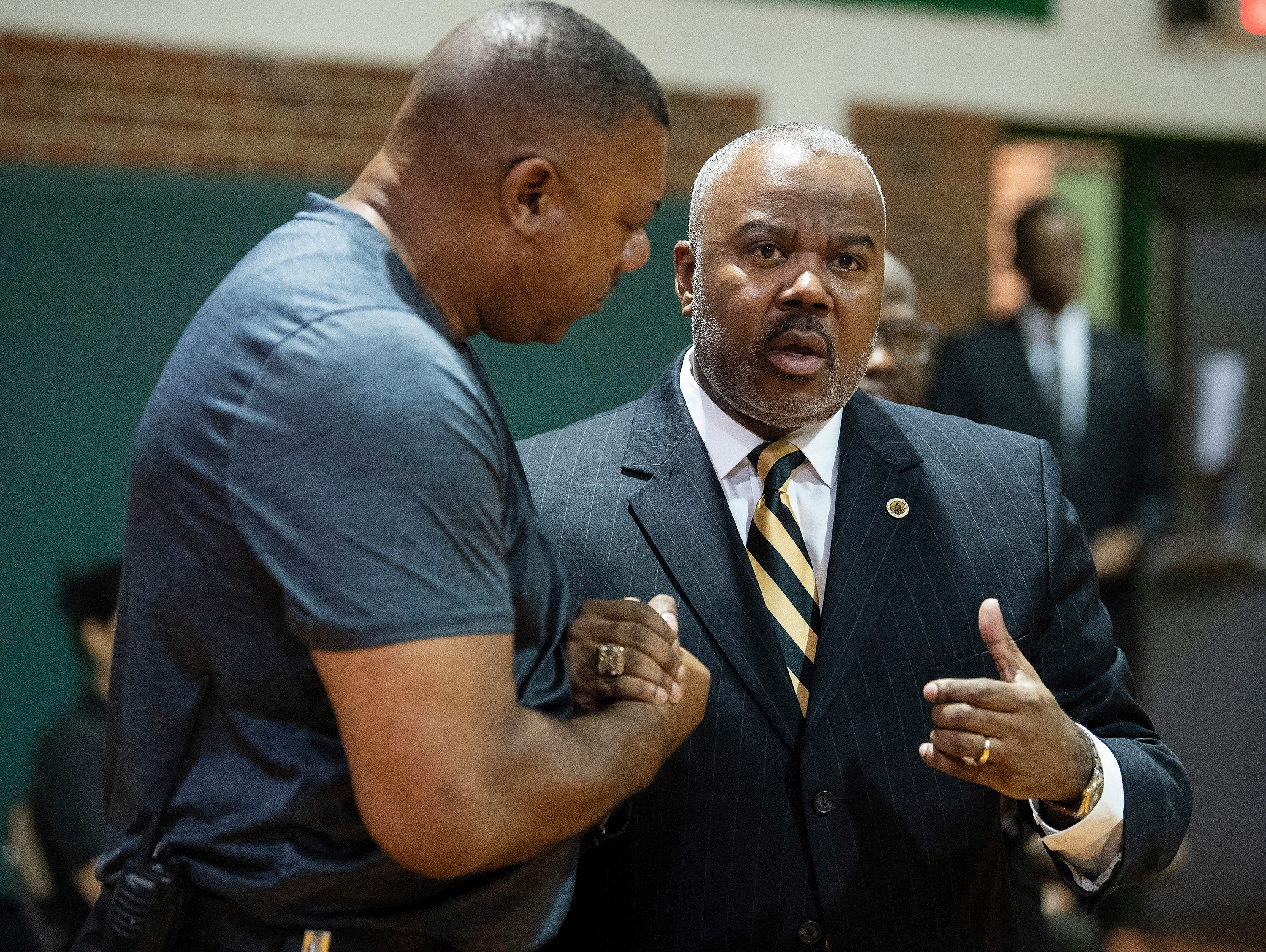 Alabama State University President Quinton Ross, right, talks with Jeff Davis High School Principal Bobby Abrams as the ASU President's Tour visits the school in Montgomery, Ala., on Friday April 12, 2019.