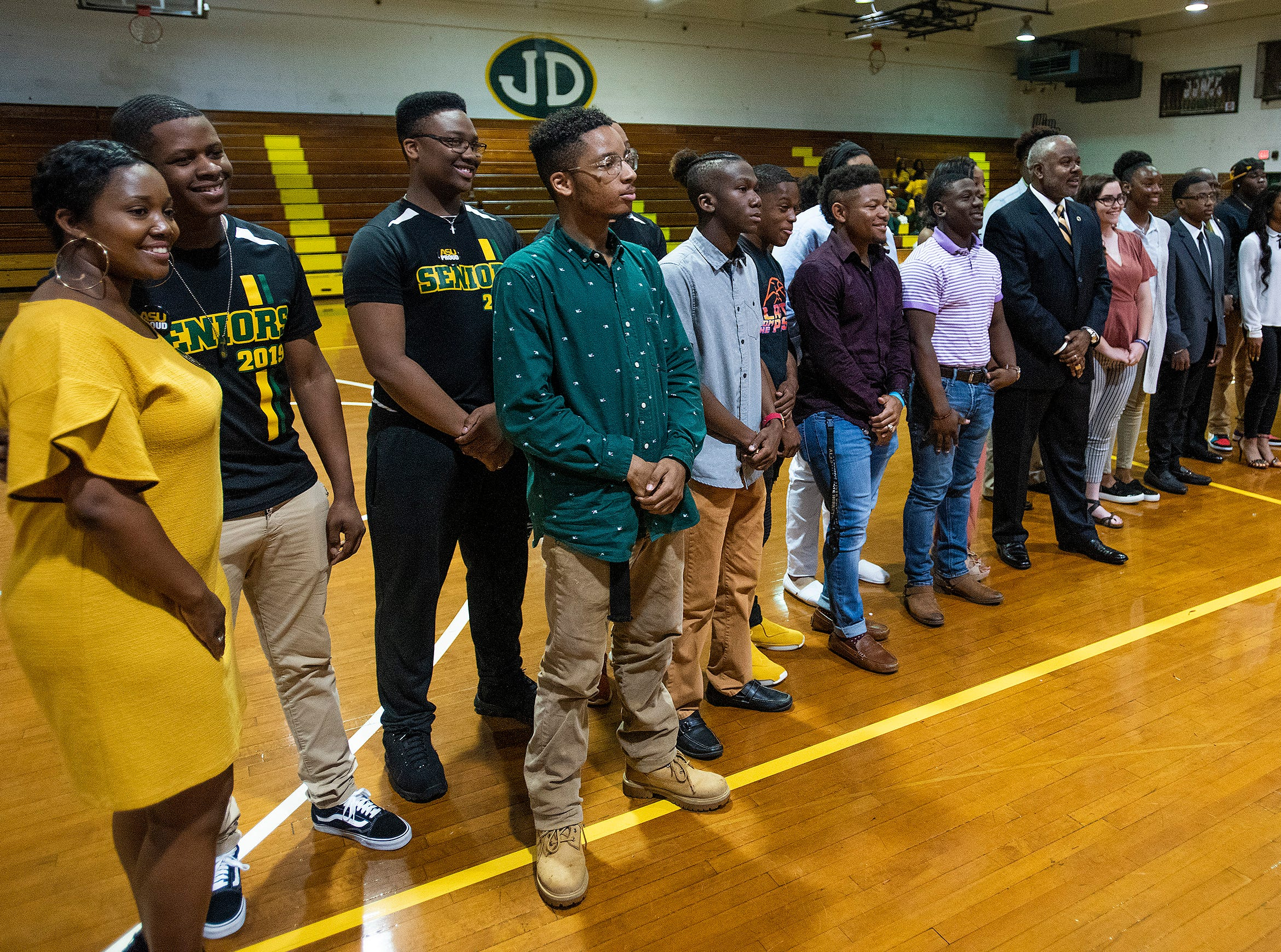 Alabama State University President Quinton Ross poses for photos with Jeff Davis High School students that received scholarships to ASU during the ASU President's Tour stop at the school in Montgomery, Ala., on Friday April 12, 2019.