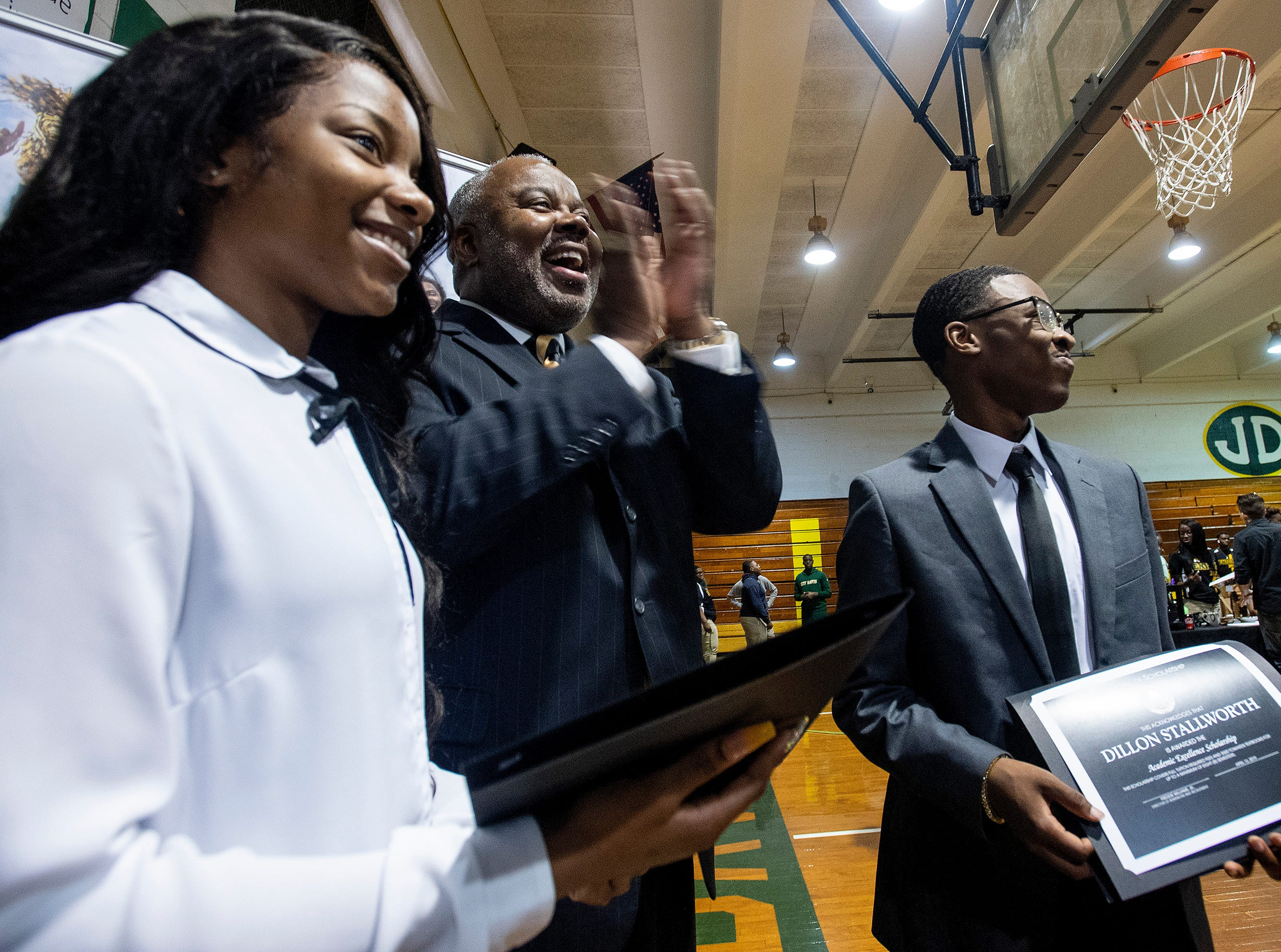 Alabama State University President Quinton Ross talks with Scholarship winners from Carver High School,  Kiondra Woods, left, and Dillon Stallworth during the ASU President's Tour stop at Jeff Davis High School in Montgomery, Ala., on Friday April 12, 2019.