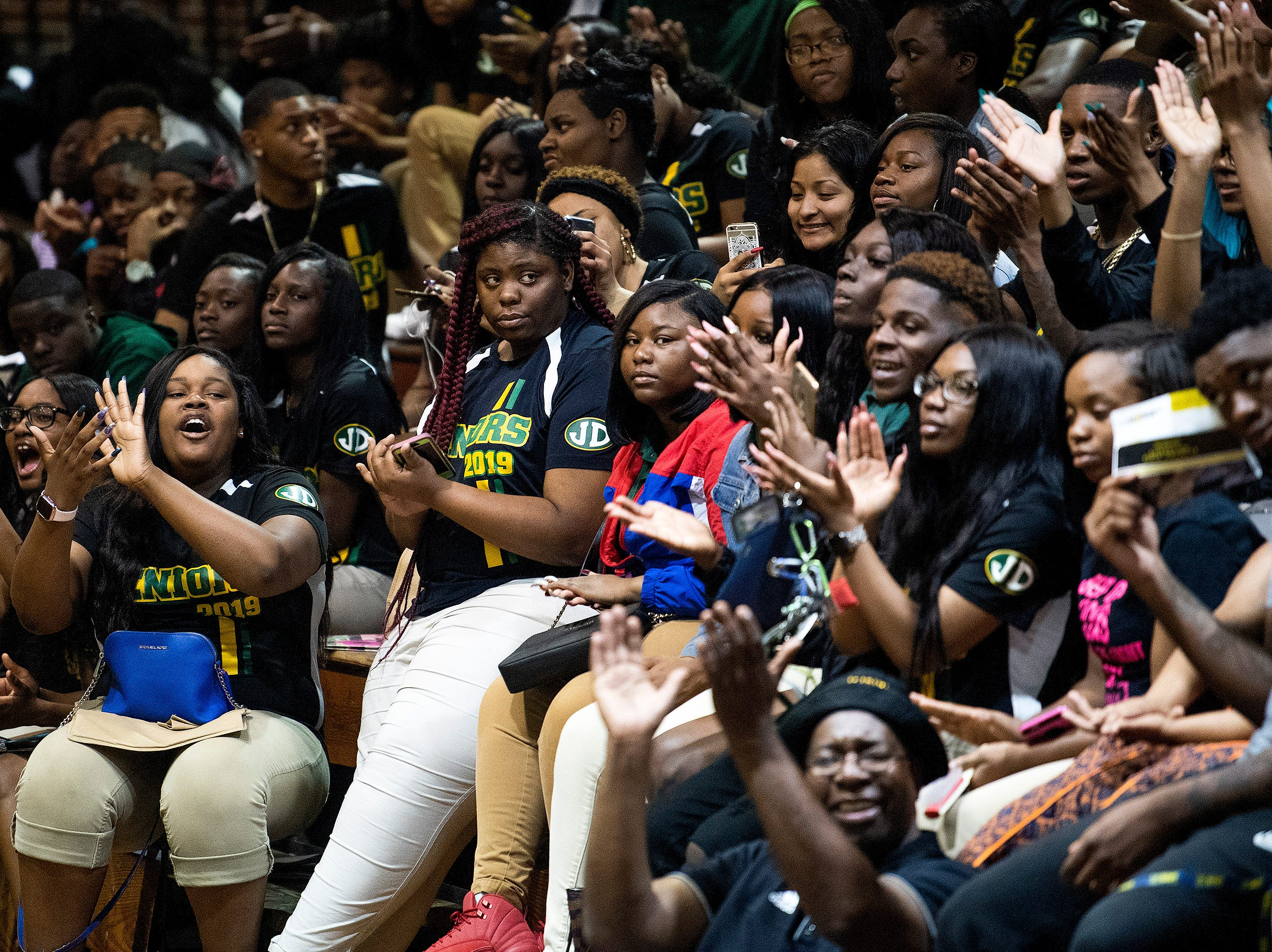 Jeff Davis High School students clap during performances by Alabama State University students during the ASU President's Tour stop at Jeff Davis High School in Montgomery, Ala., on Friday April 12, 2019.