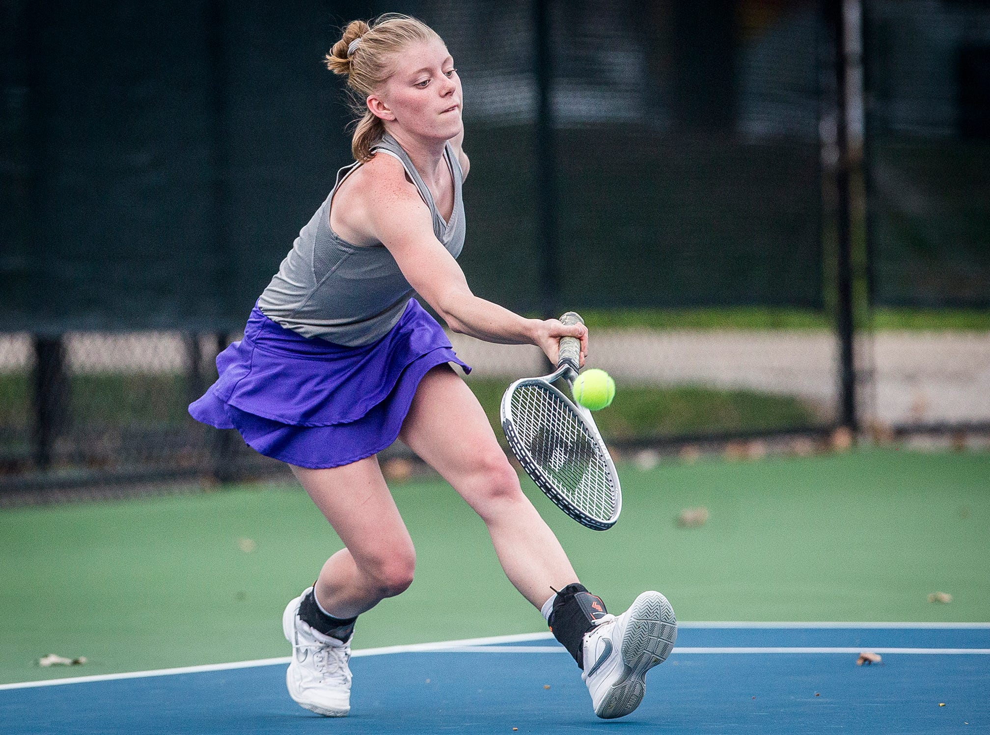 Central's Catherine Dragiciu competes against Burris during her singles match at Ball State Thursday, April 11, 2019.