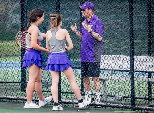 Central tennis coach Don Wafer gives instructions during the match against Burris at Ball State Thursday, April 11, 2019.