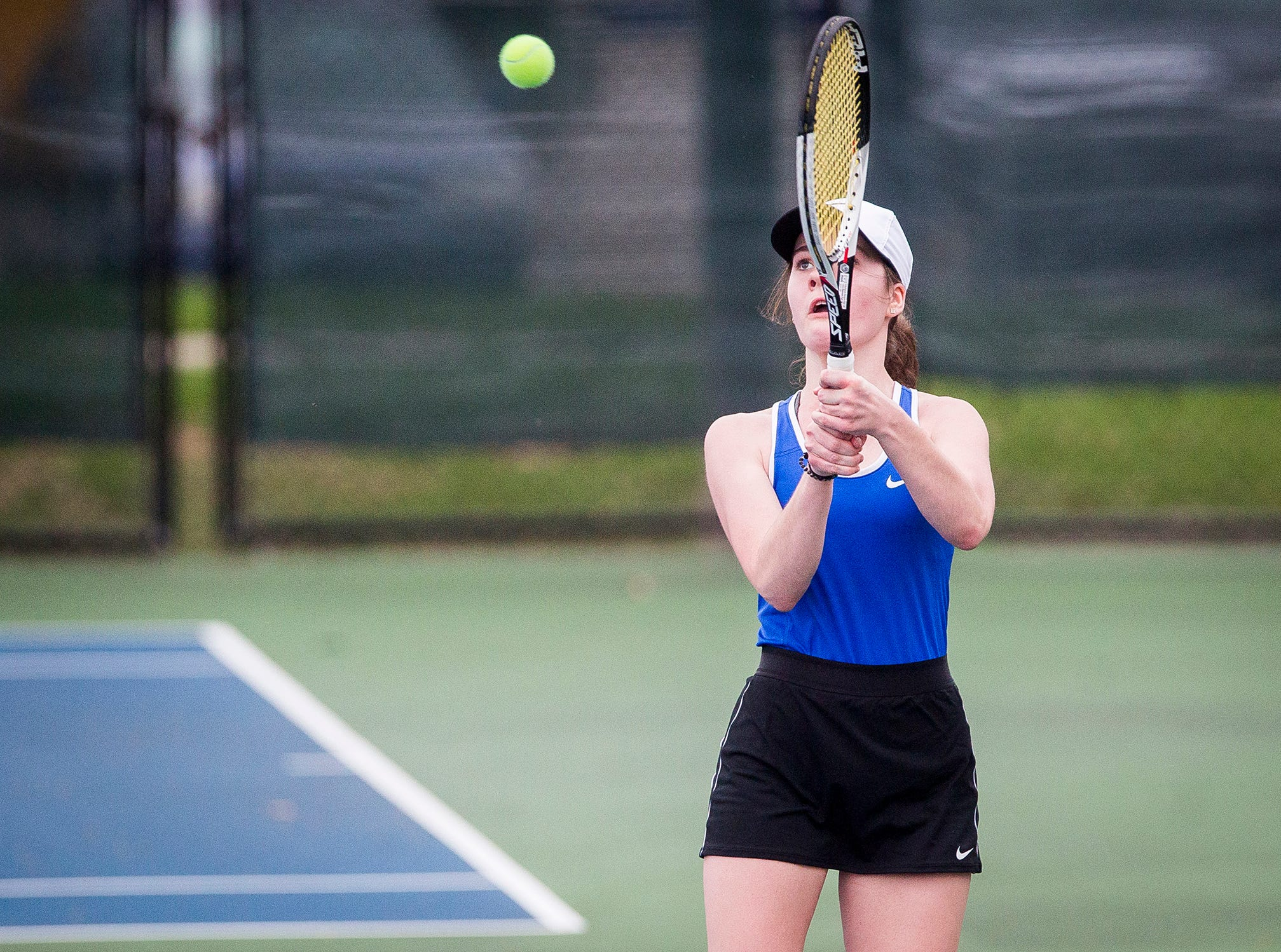 Burris' Sarah Billiter hits against Central's Catherine Dragiciu during her singles match at Ball State Thursday, April 11, 2019.