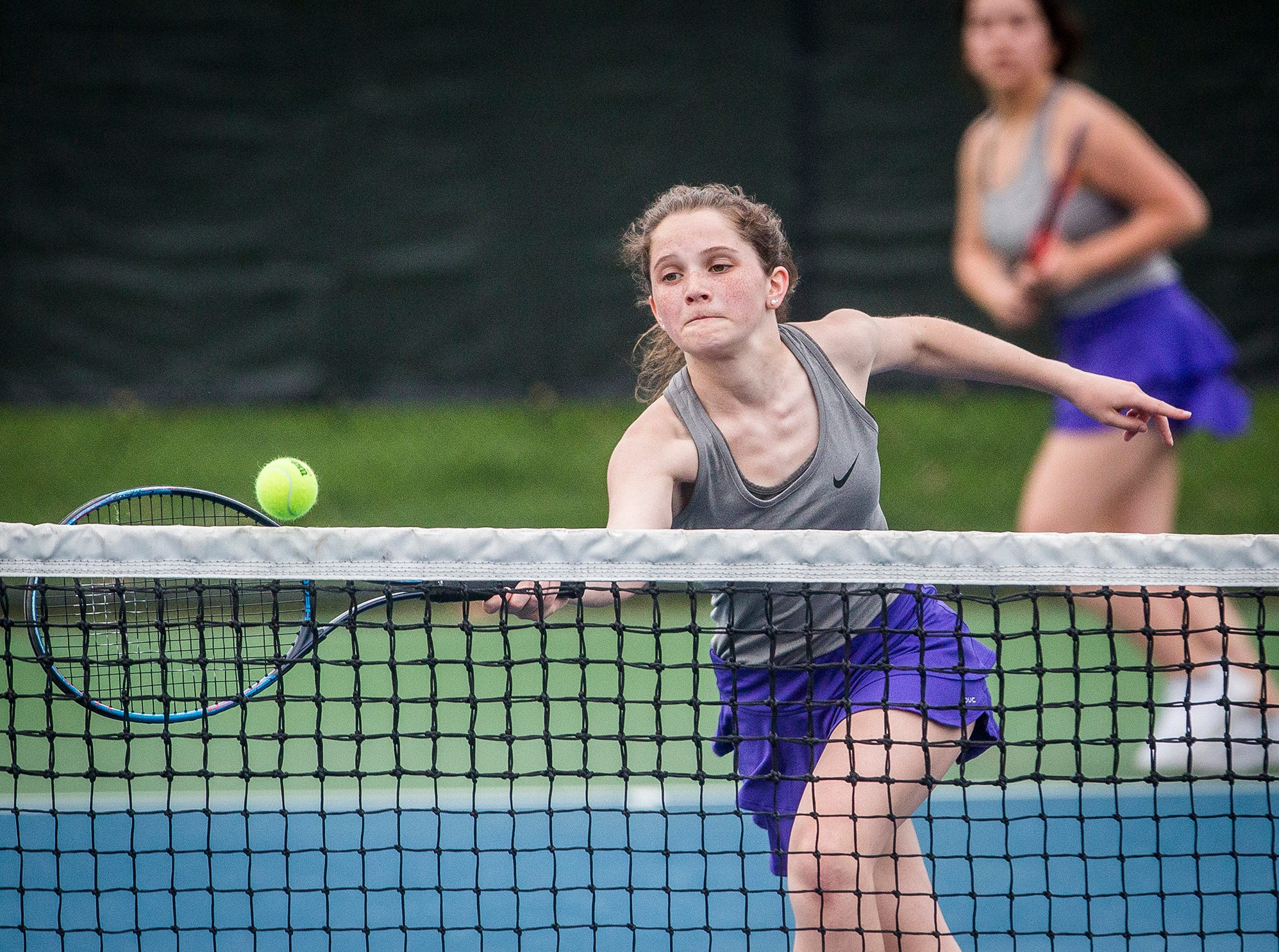 Central's Gracie Evans and Amelia Onate compete against Burris' Edom Alemayehu and Rosie Bracken during their singles match at Ball State Thursday, April 11, 2019.
