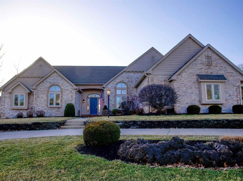 This home sits at 609 S. Turnberry Lane in Yorktown and holds four bedrooms (though there's potential for six), 3.5 bathrooms, a three-car garage and a curved driveway at the front.