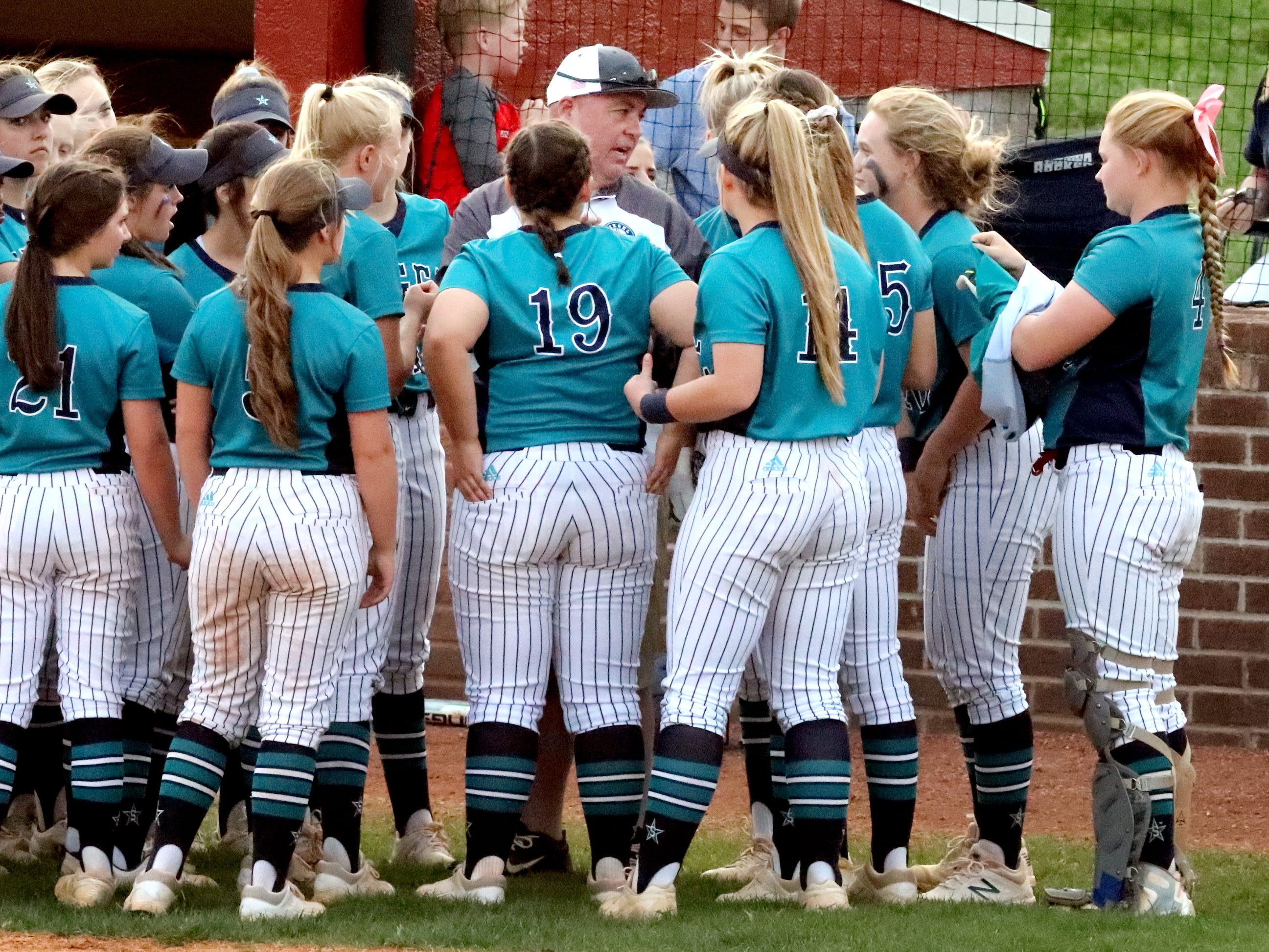 Siegel's head coach Shawn Middleton talks with players before the game against Riverdale on Thursday April 11, 2019, at Riverdale.