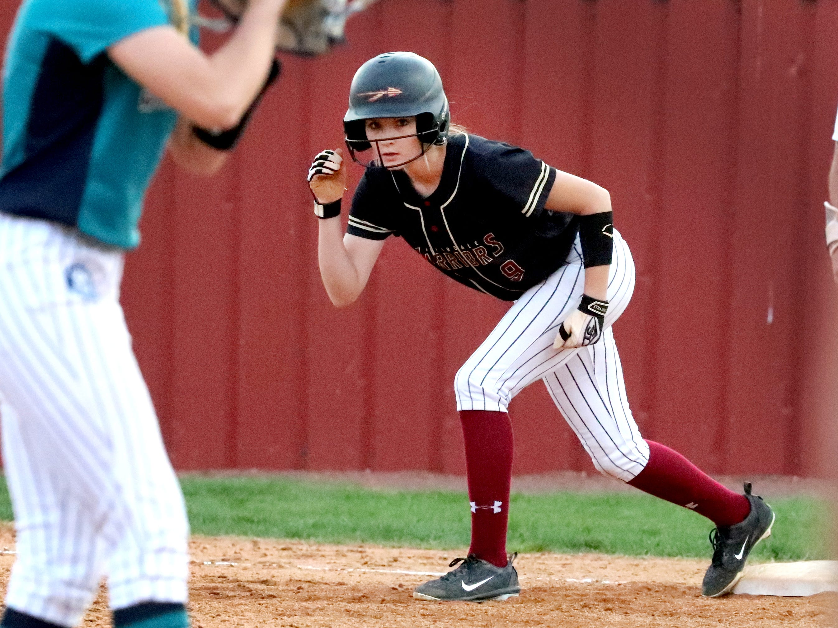 Riverdale's Breanna Bailey (9) watches the pitch from first base as she gets ready to run during the game against Siegel on Thursday April 11, 2019, at Riverdale.