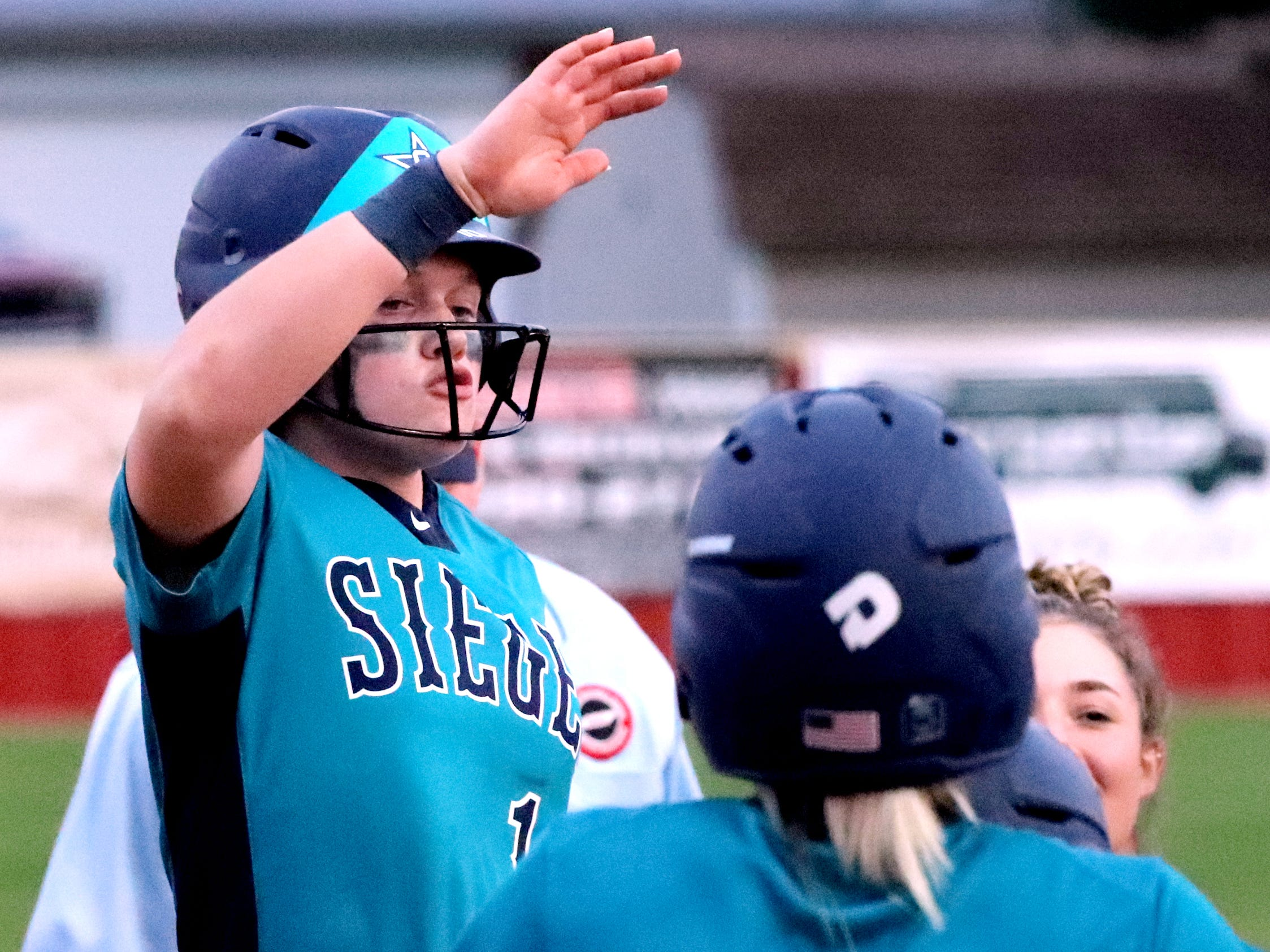 Siegel's Caitlyn McCrary (10) celebrates her home run at home plate with her team during the game against Riverdale on Thursday April 11, 2019, at Riverdale.