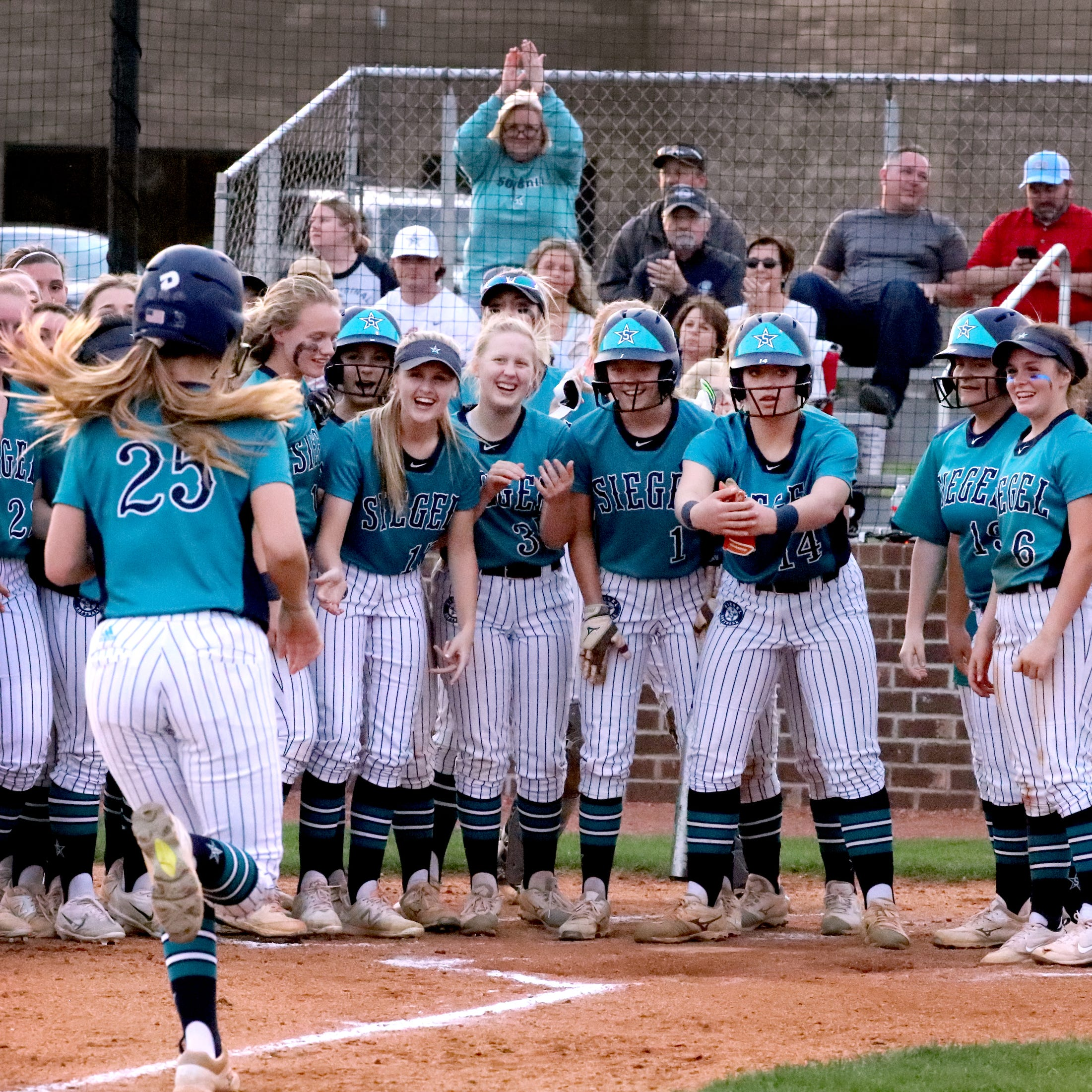 Siegel's Sophie Golliver (25) is congratulated at home plate after hitting a home run against Riverdale on Thursday April 11, 2019, at Riverdale.