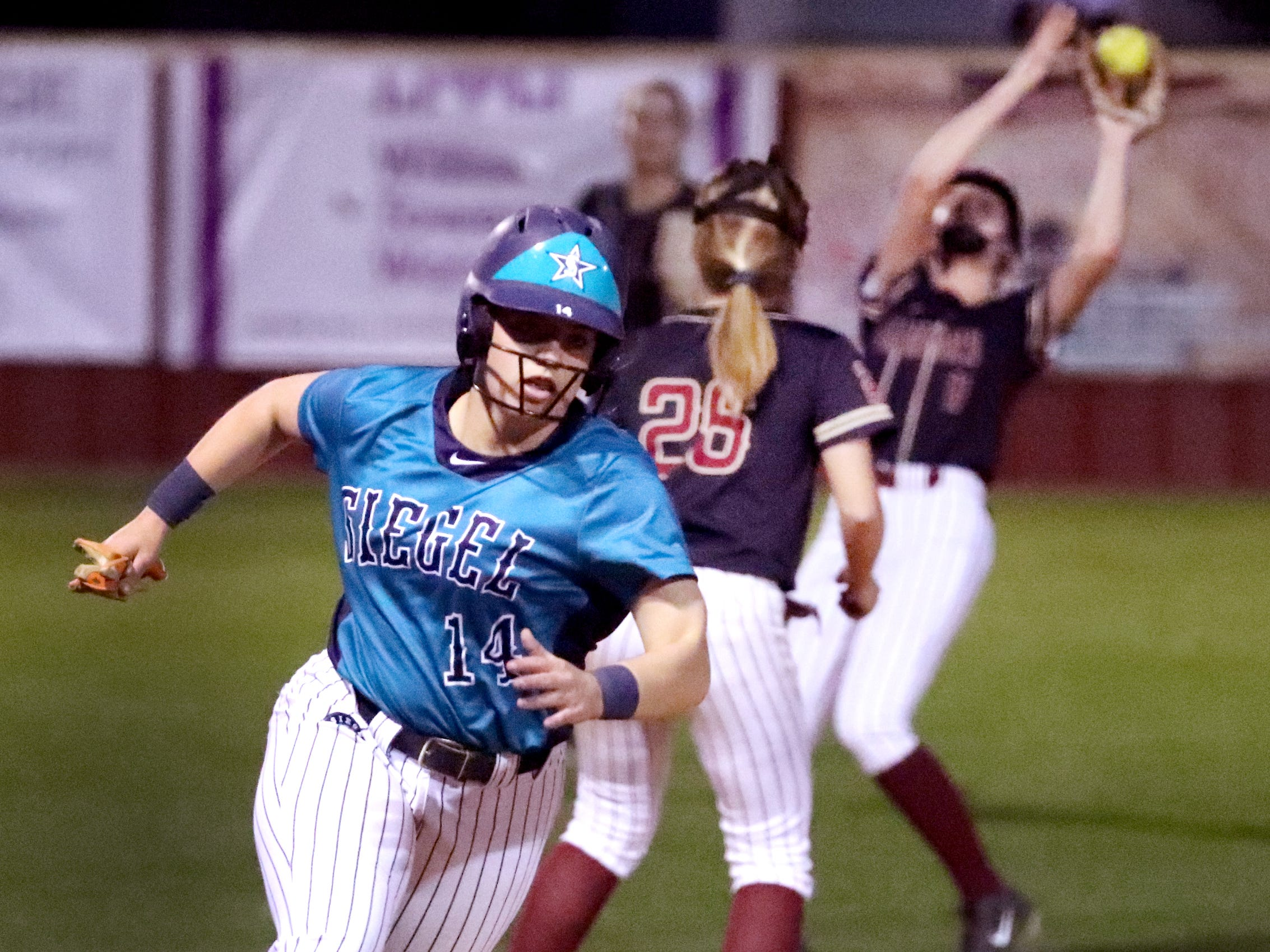 Siegel's Claire Czajkowski (14) rounds third base as she goes on home to score against Riverdale on Thursday April 11, 2019, at Riverdale.