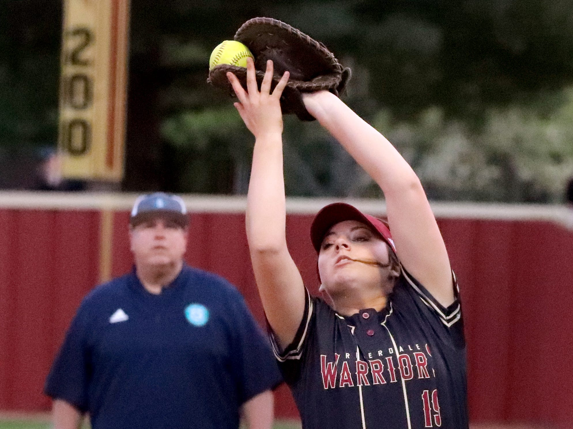 Riverdale's Sarah Margaret Lowe (19) catches the ball for an out a Siegel player on Thursday April 11, 2019, at Riverdale.