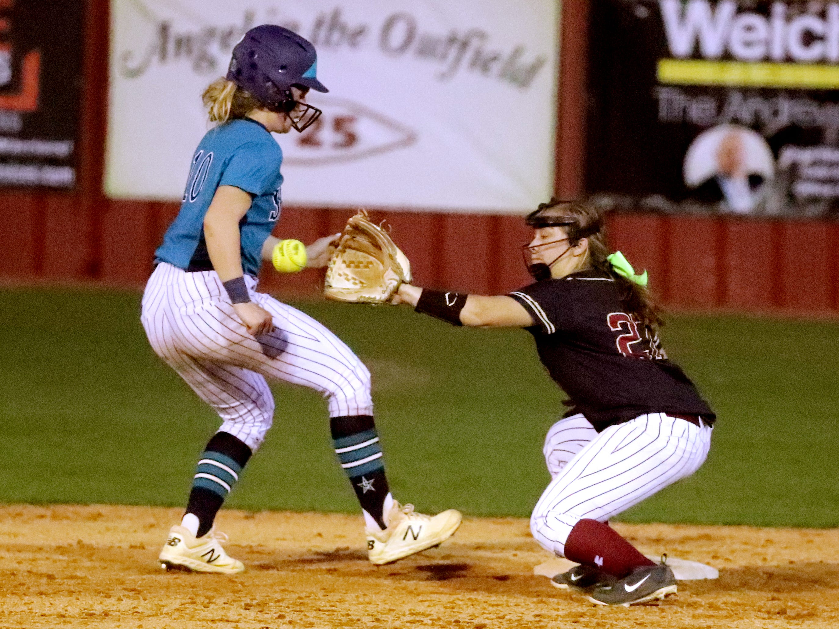 Riverdale's Brooklynn Ott (27) tries to out Siegel's Caitlyn McCrary (10) on second base on Thursday April 11, 2019, at Riverdale.