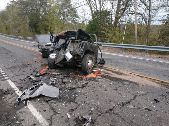 A driver apparently clipped an Ashland City patrol vehicle before hitting a flatbed truck head-on in a multi-vehicle crash on Highway 49 East on Friday, April 12.